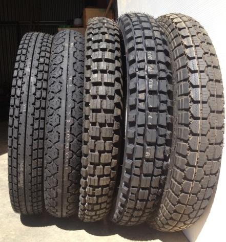 "Tyres Left to Right: 400-18 Heidenau K28 4 ply square $229 400-18 Heidenau K36 4 ply road $199 400-19 Duro 307 6 ply block (not available) 400-19 Heidenau K37 4 ply block $185 400-19 Duro 308 6 ply road $129, also available in 18"" $119"