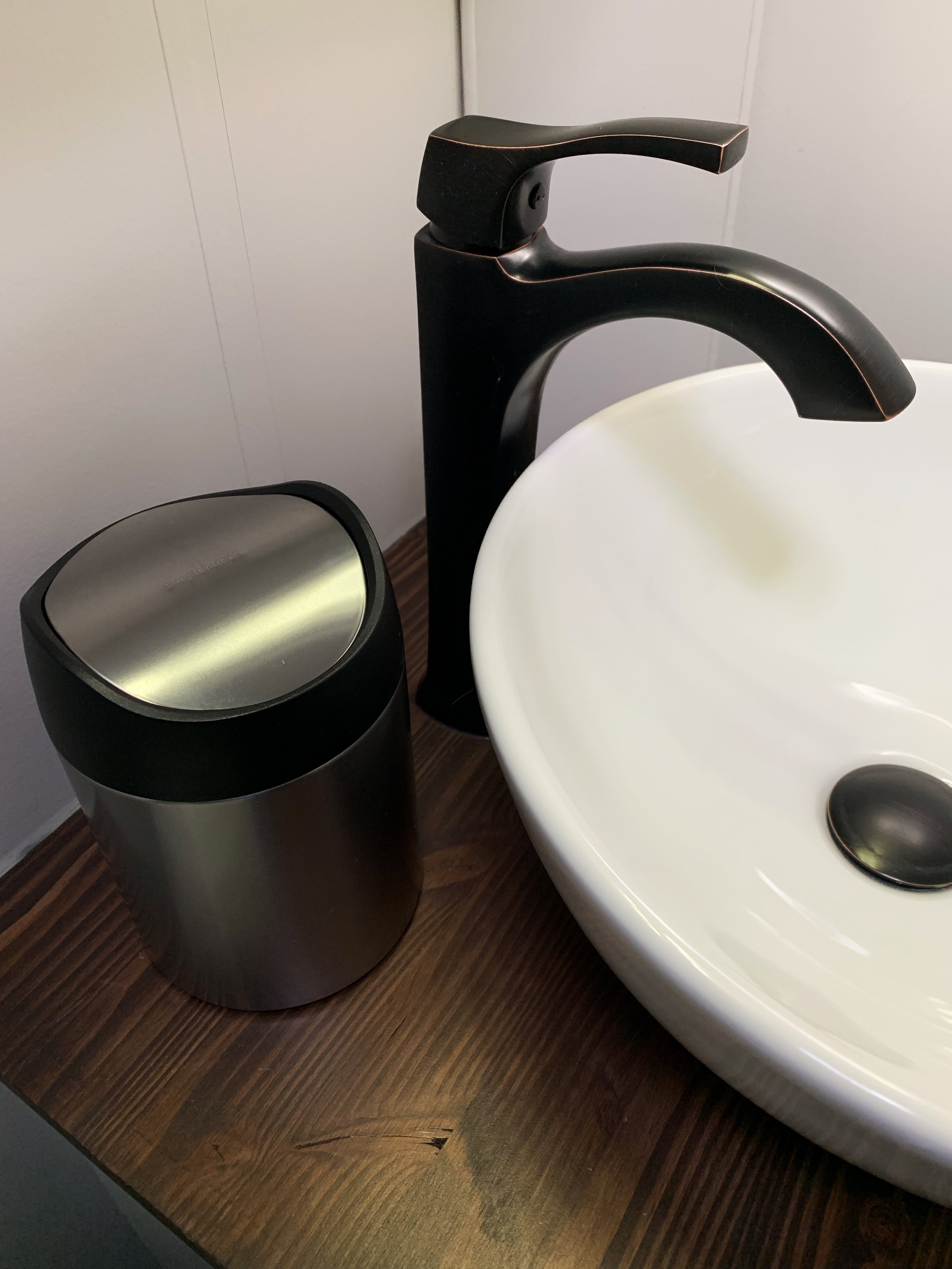 "Our $15 simplehuman trash can - 7.4"" x 5"" diameter"