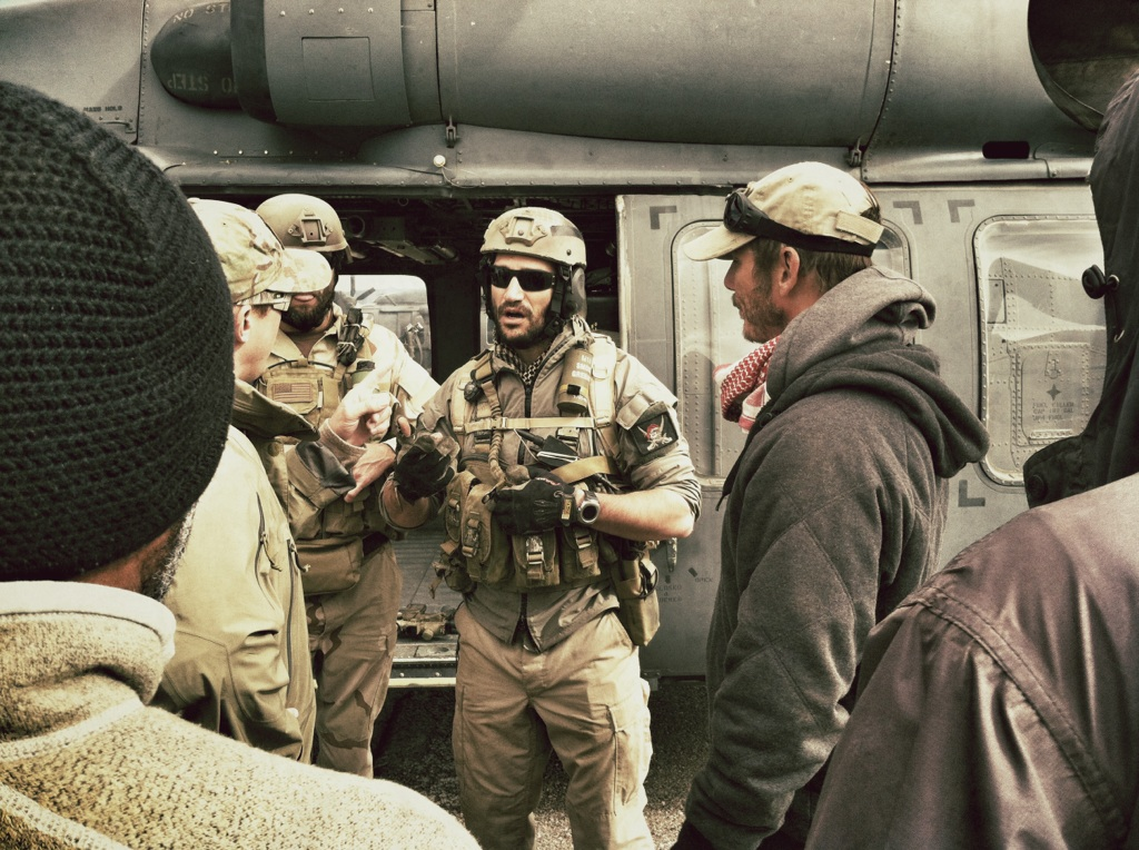 Photo: Mark Semos, center, advises director Pete Berg and crew on the set of Lone Survivor