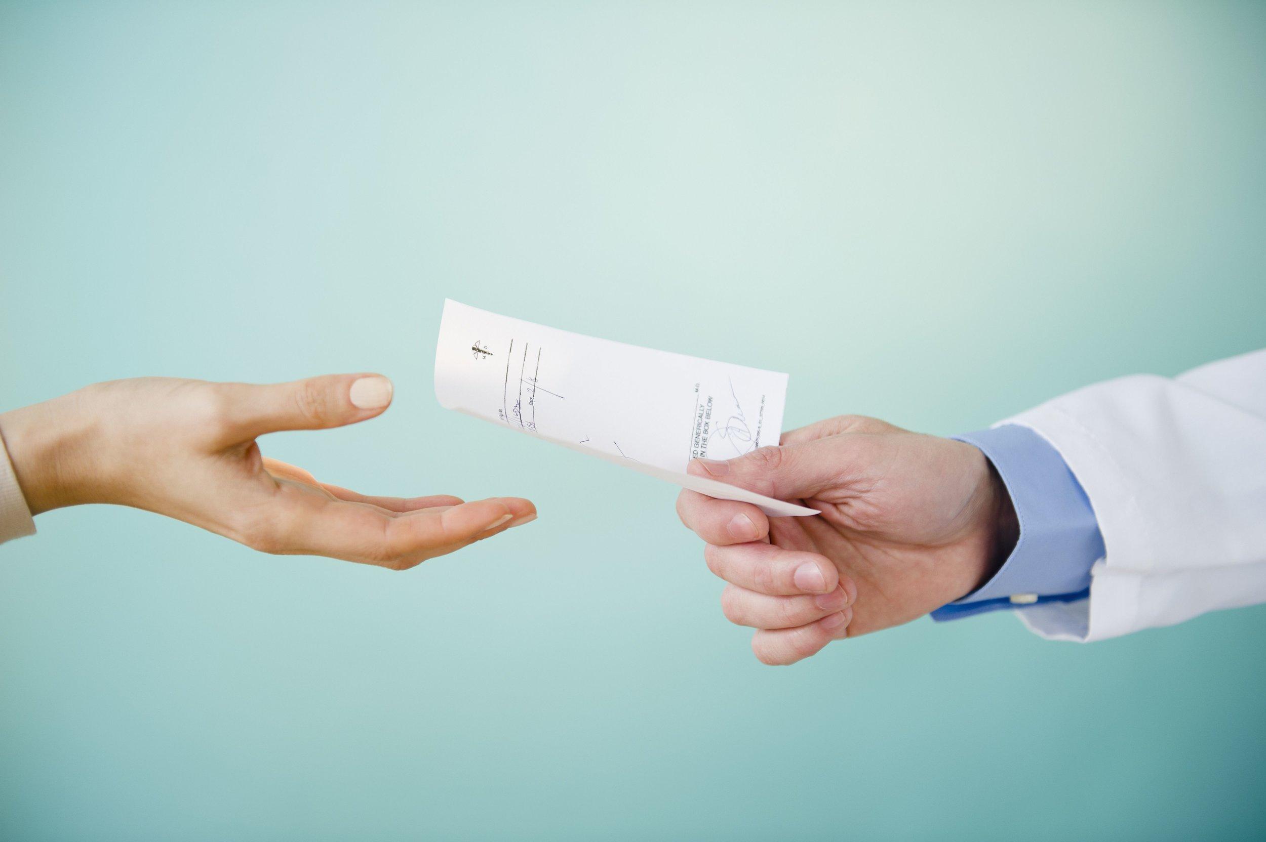 close-up-of-doctor-s-hand-giving-prescription-to-patient-studio-shot-149262483-5877e1b73df78c17b62c3376.jpg