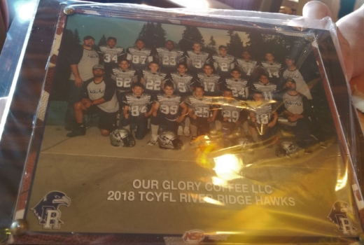 The plaque OG was presented from the Thurston County Youth Football League River Ridge Hawks.
