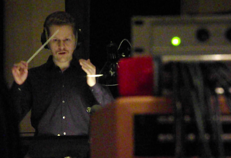 Jacob Conducting from Mix Room.png
