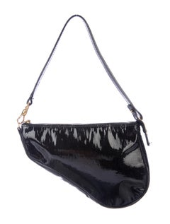 The patent leather on this bag is a bold choice.