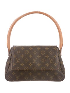 This bag is adorable, and would go great with a black slip skirt and a camel-colored sweater.