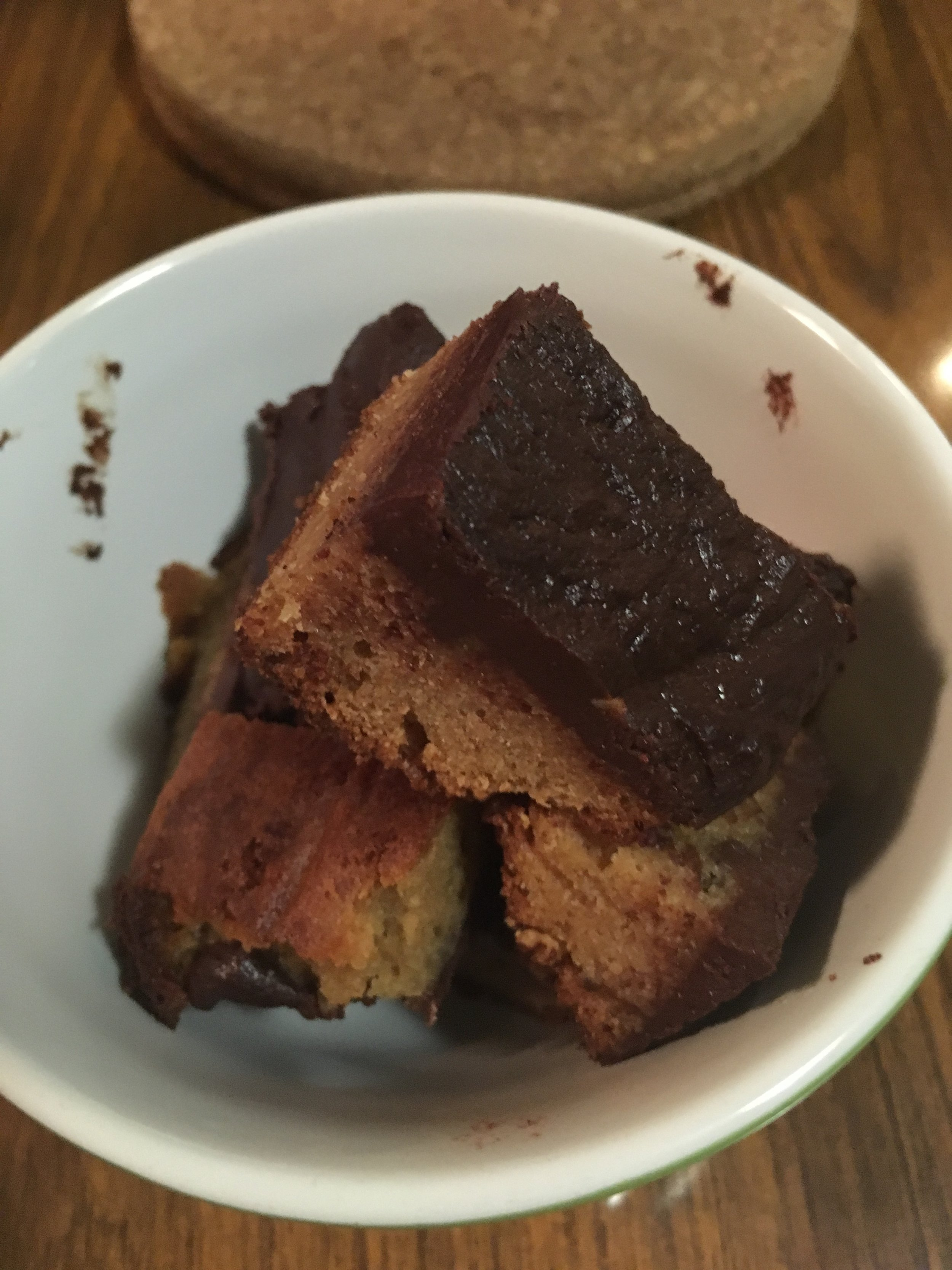 - Tip the brownies unto a plate and pour the melted chocolate mixture the hot brownies and enjoy!