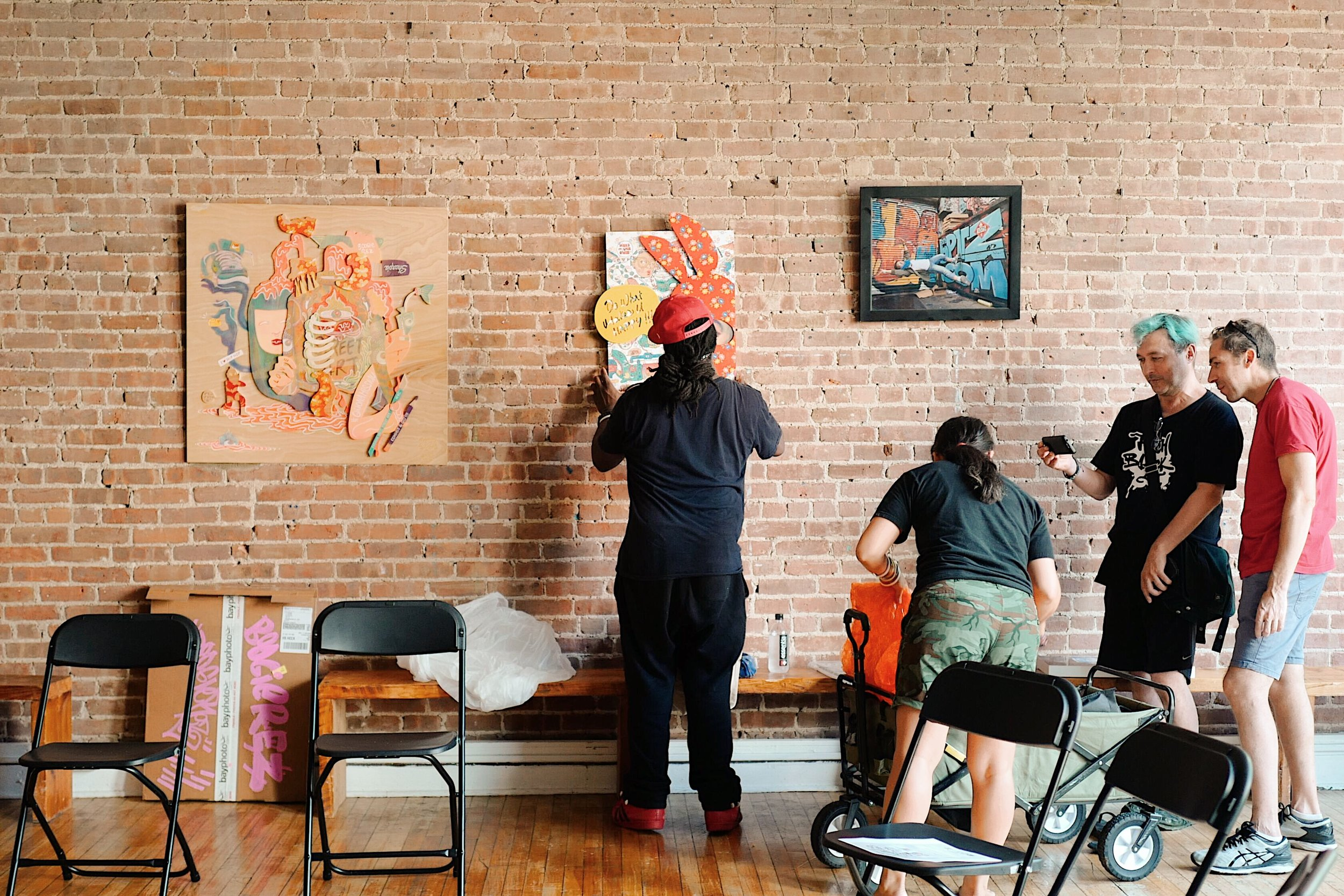 Before the event, artists Boogie and Rezones setting up their artworks.