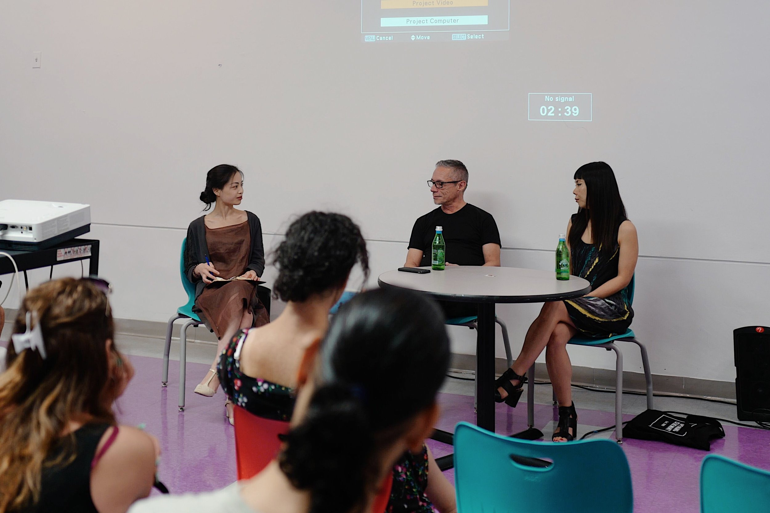 Curatorial director Irina Li moderating the panel discussion with street artists CoCo 144 and Lady Aiko.
