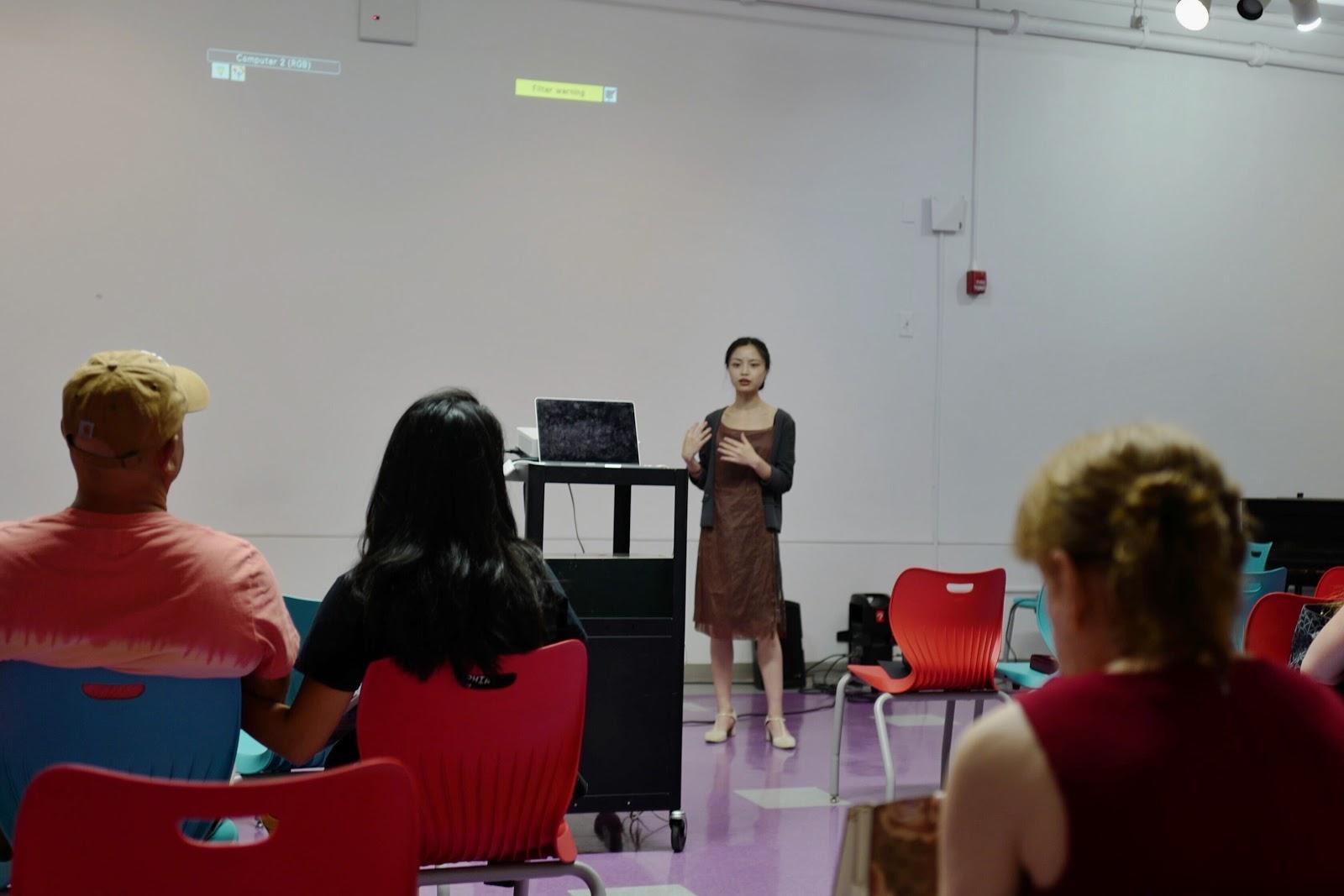 Curatorial Director Irina Li introducing the documentary and the street artists.