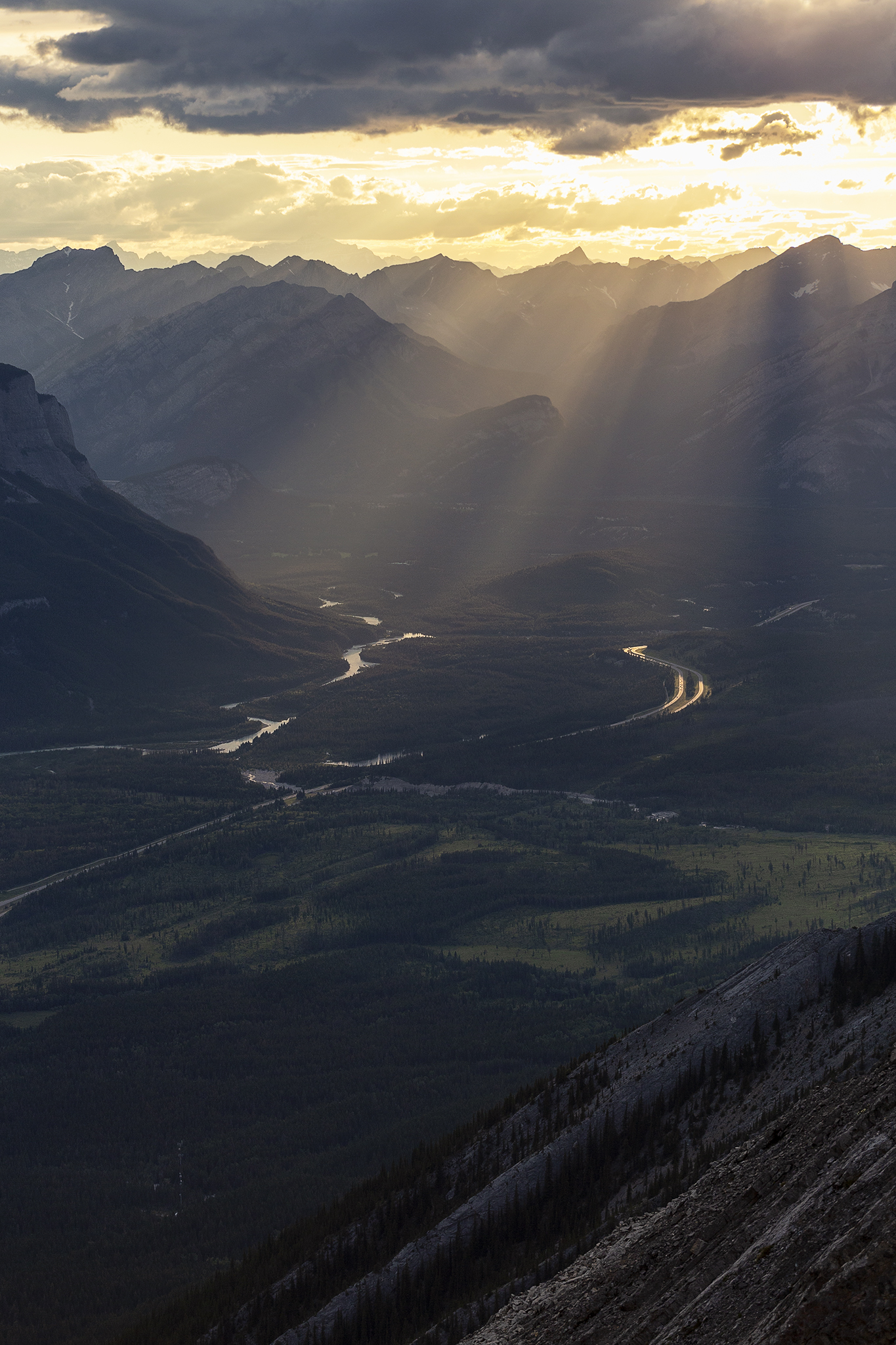 Sun beams through the valley, another view before the ridge line.