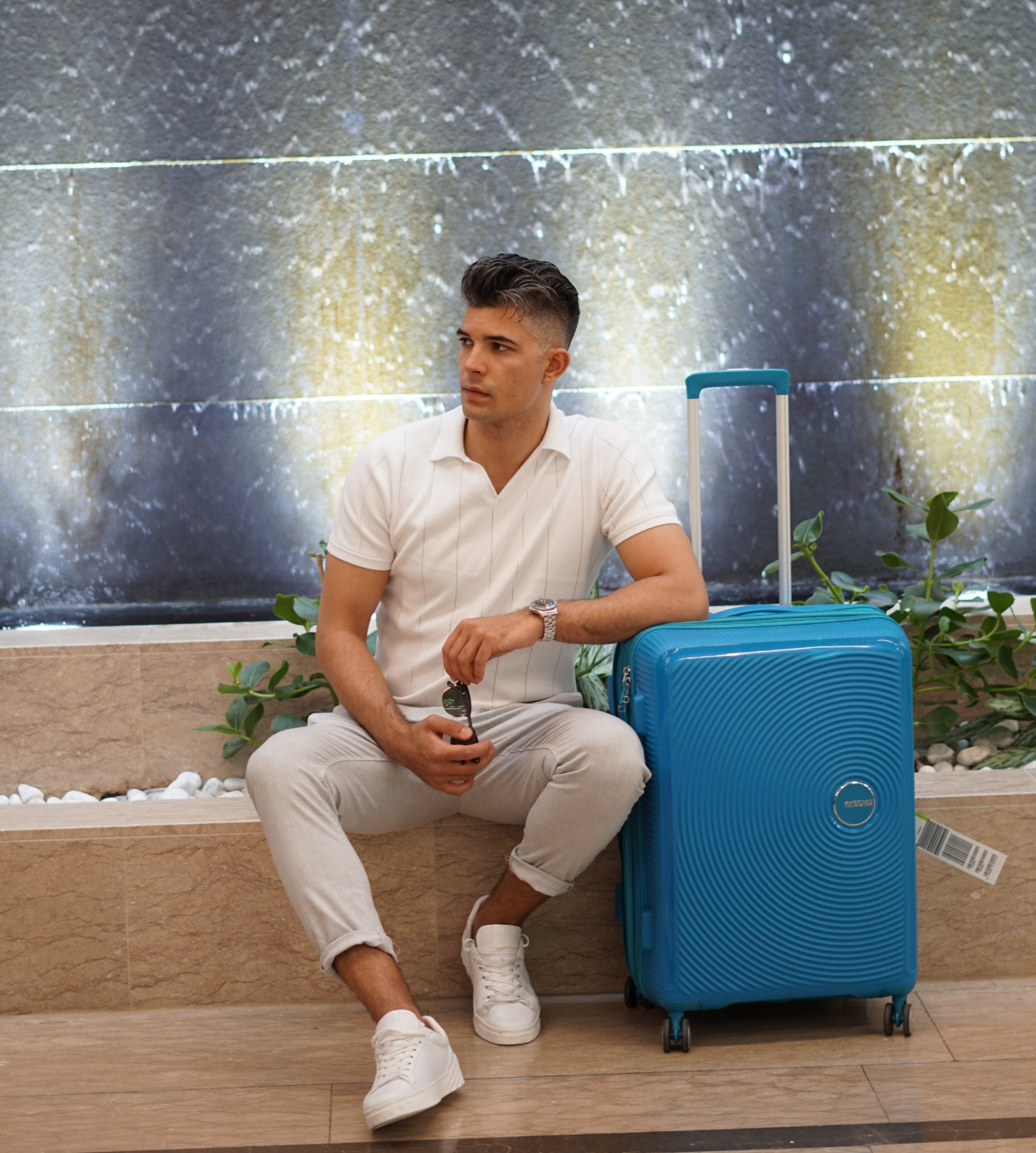 Here is a photo of him looking super cool with the American Tourister luggage. How does he always look so cool?