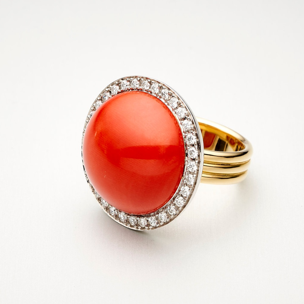 BUNDA 'bundova' ring with a coral cabochon and DIAMONDS, set in 18ct white and yellow gold