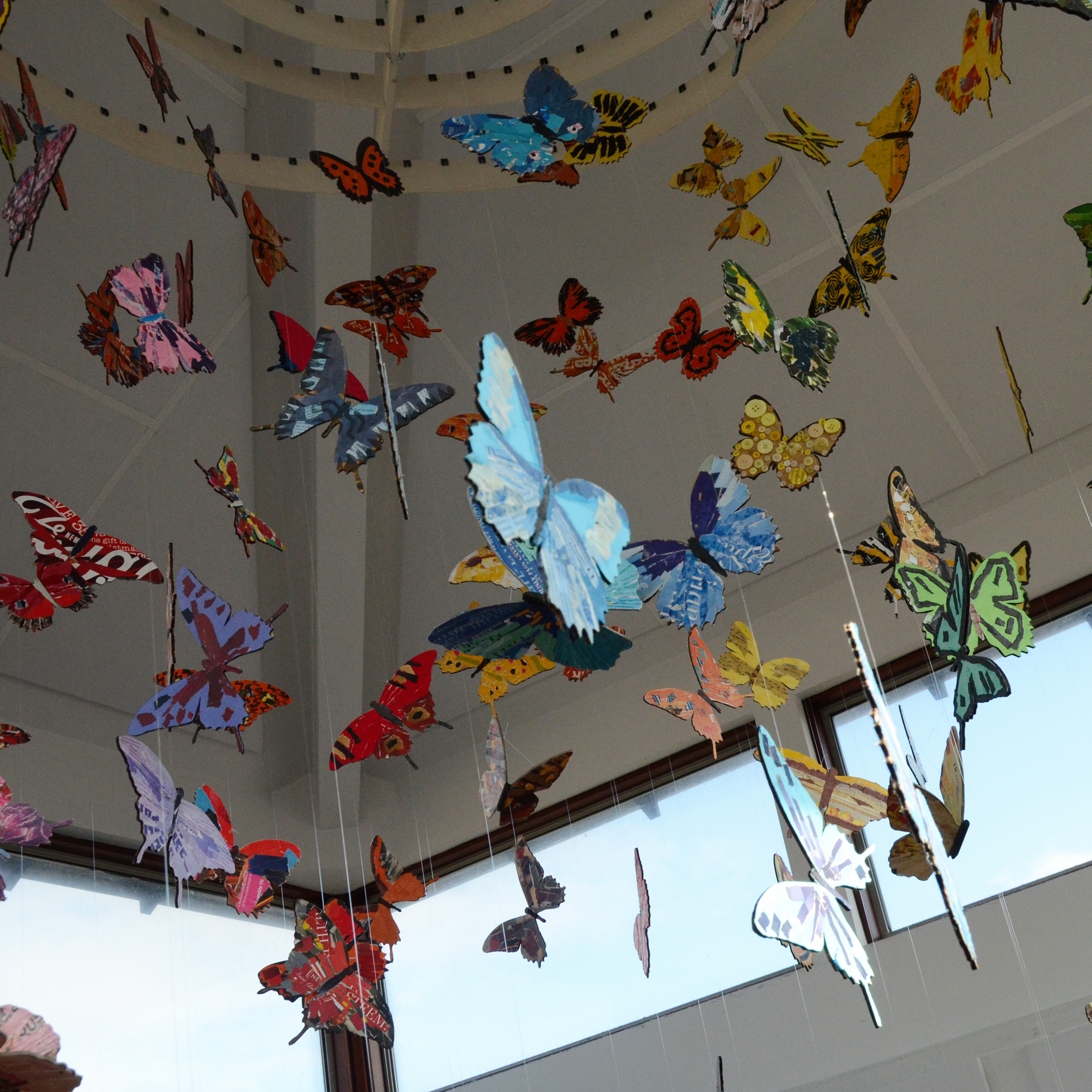 collaged butterflies hanging from ceiling