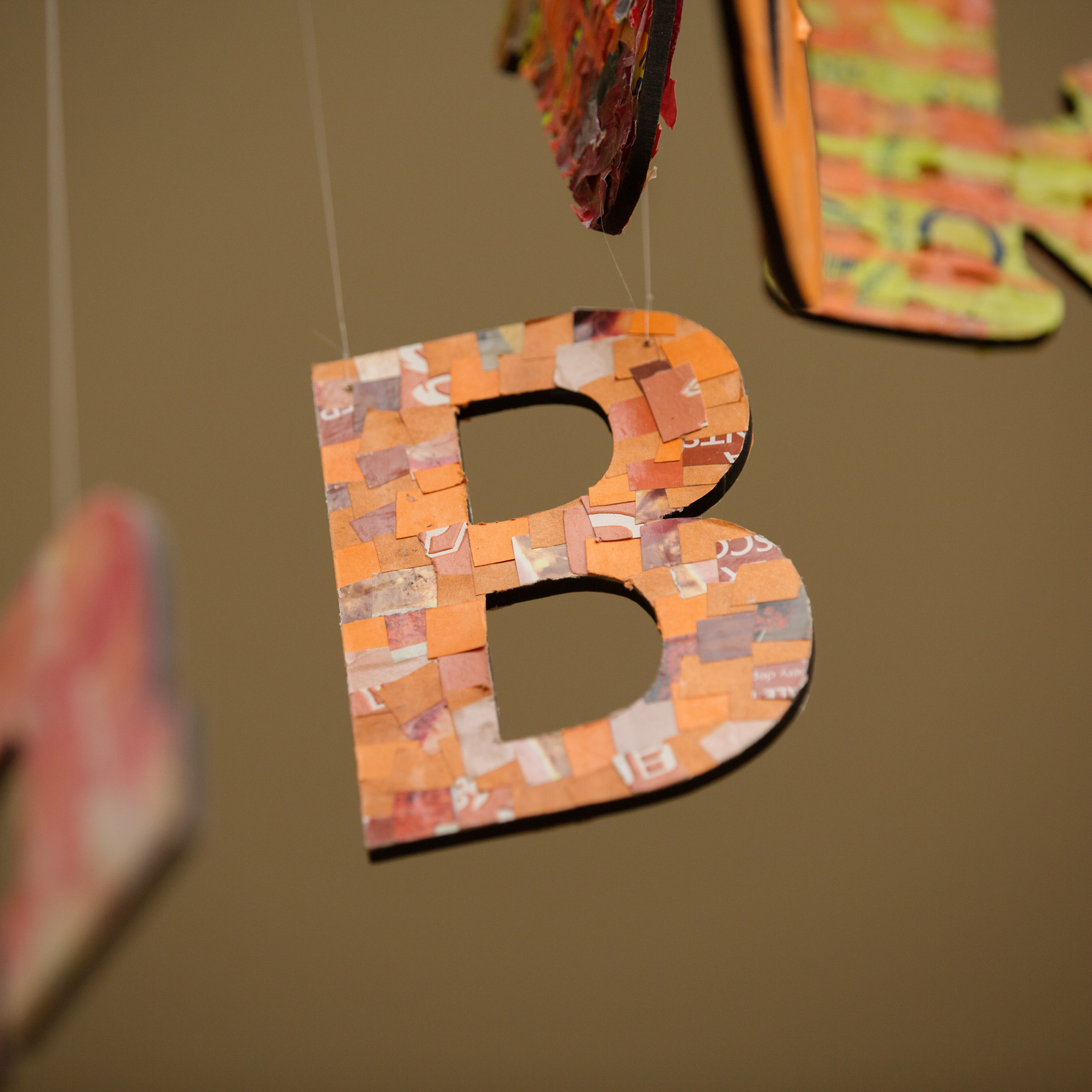 Letter B in art display made from woven plastics