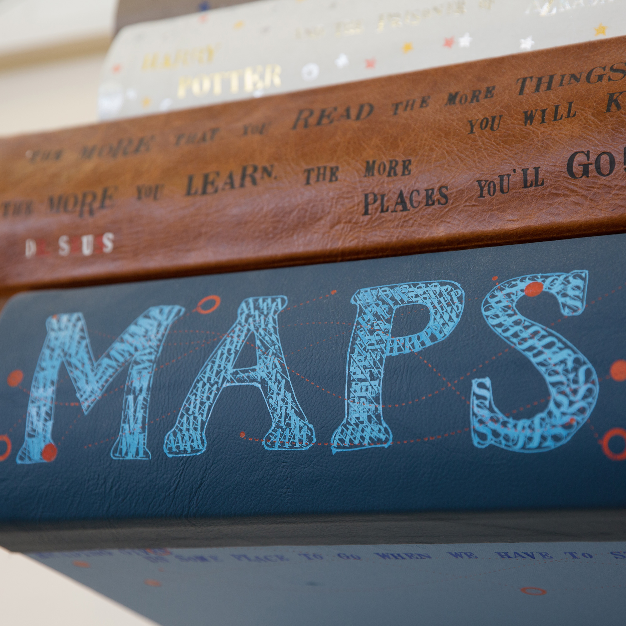 Art installation with hand etched Map book title