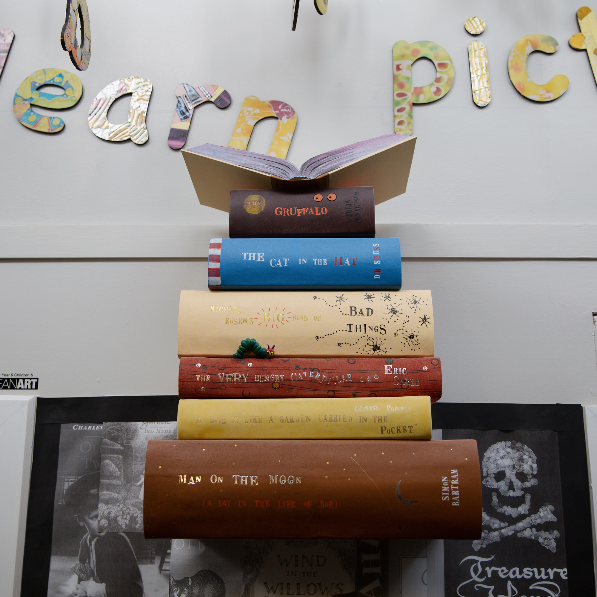 Art installation in the shape of s book pile encourages reading