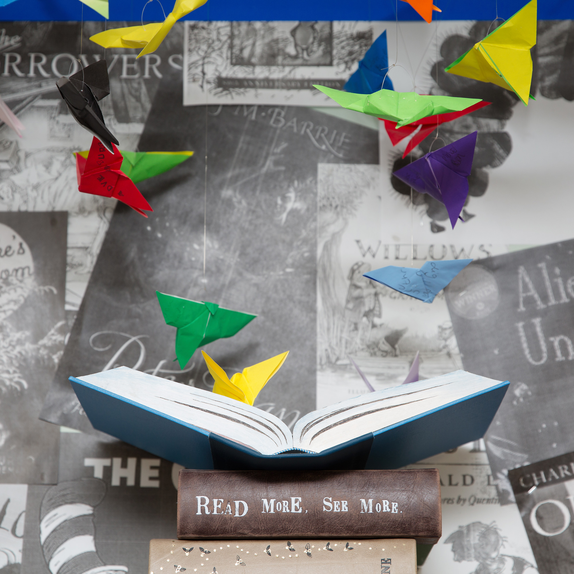 Origam butterfles fly out of art book installation