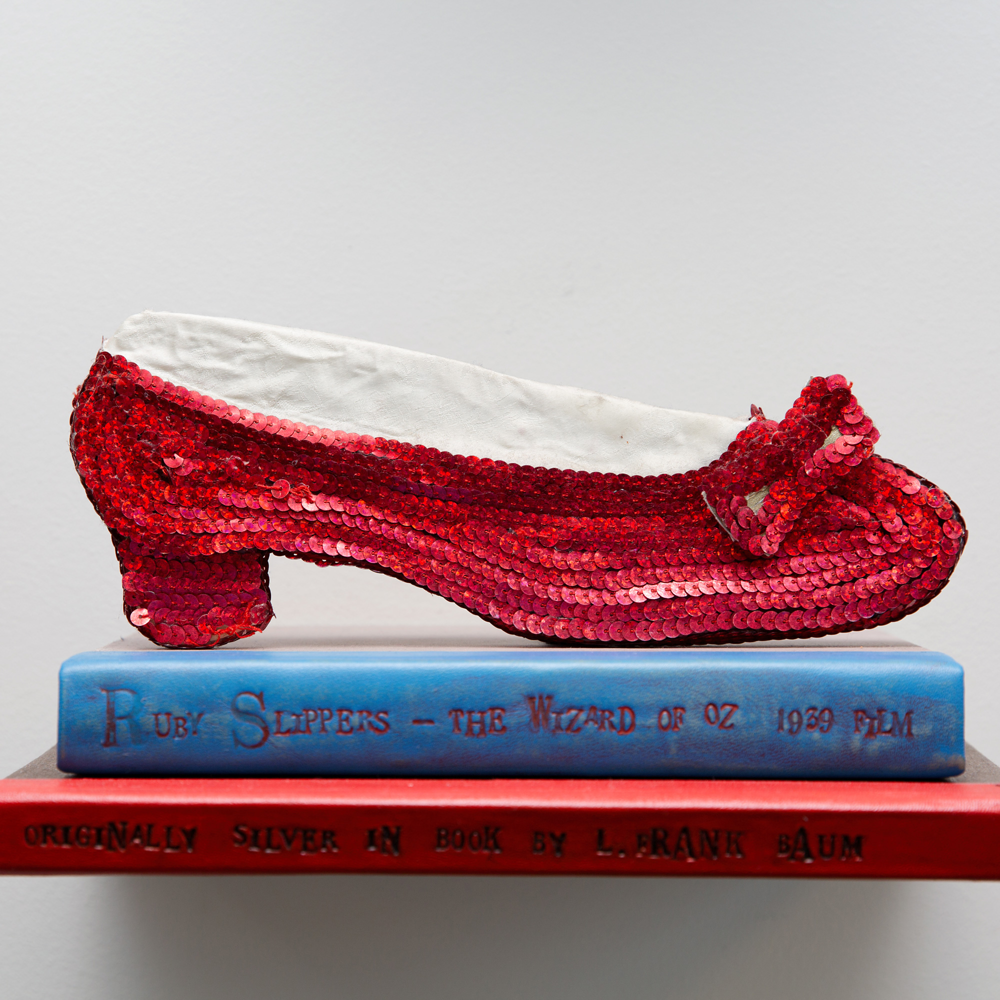 hand made two dimensional red shoe in art display