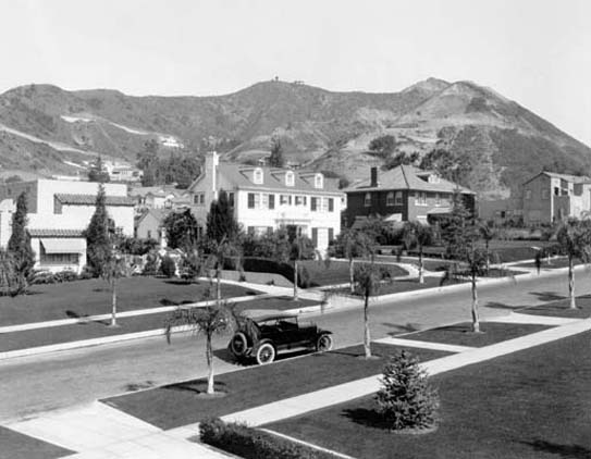 In this view from West Hollywood in the 20's, we can see the newly laid-out streets, the large, spacious homes for the rich, and the hills of Laurel Canyon in the background.