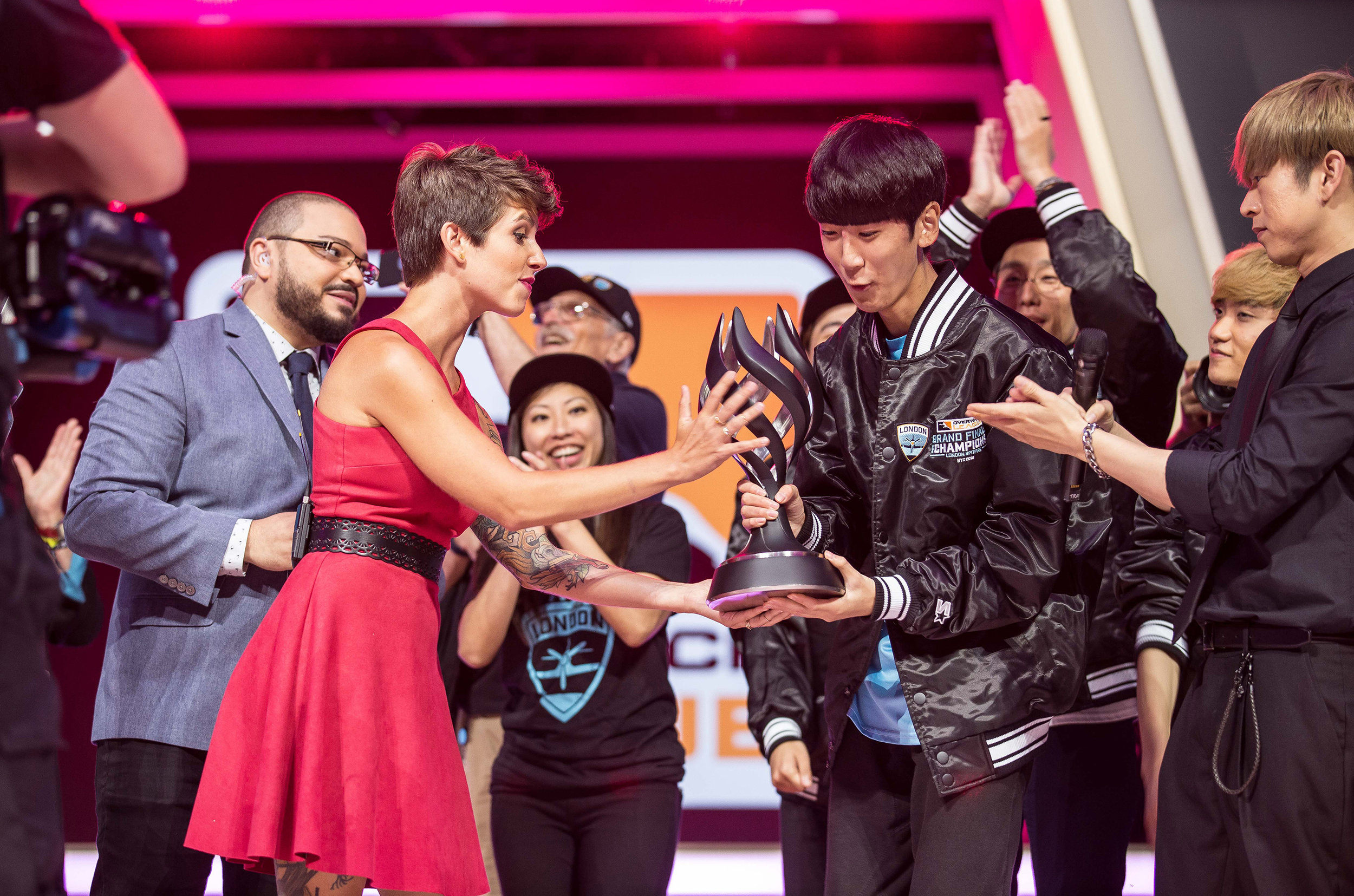 Overwatch League Grand Finals, Salome Soe Gschwind Penski carefully presenting London Spitfire'u2019s Joon-yeong 'Profit' Park with MVP trophy at Barclays Center on July 27, 2018 in Brooklyn, New York.  Photo by Hannah Smith / ESPAT Media