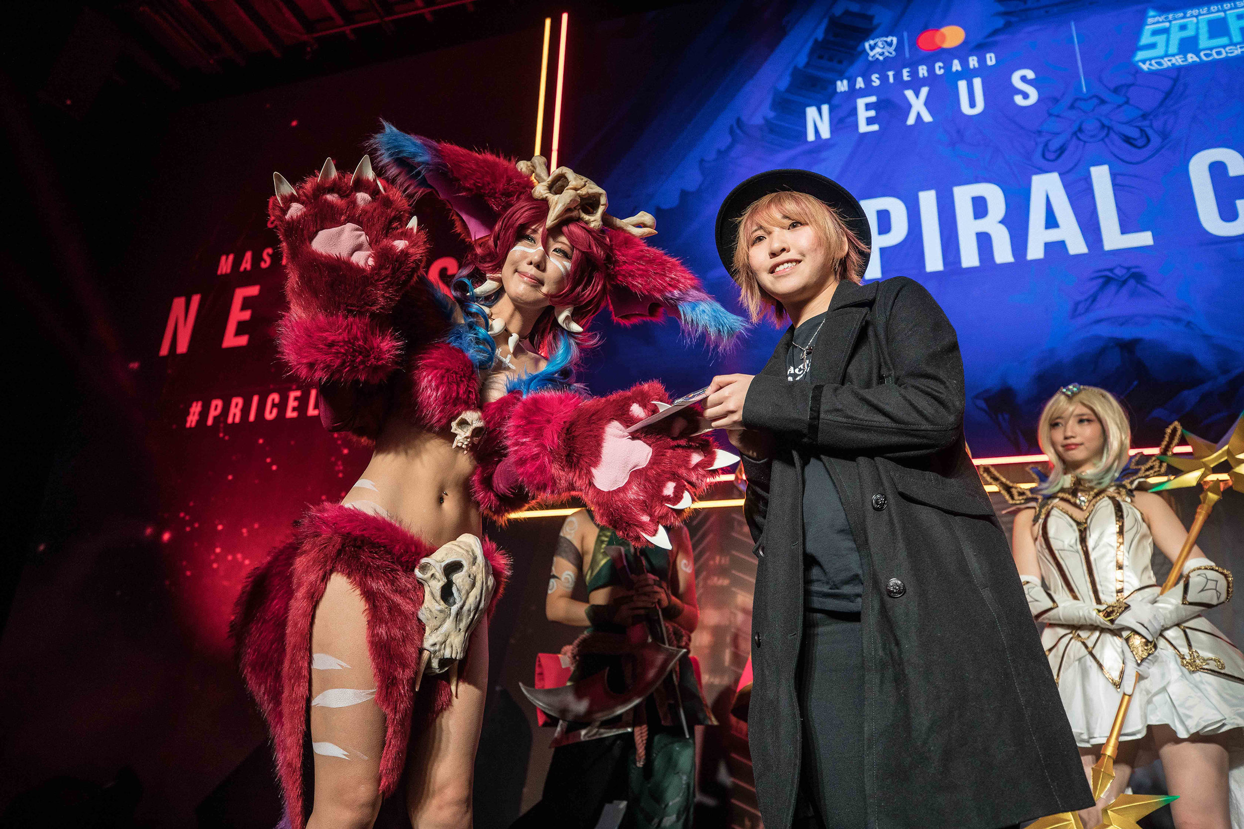 Fan wins a priceless surprise at Mastercard Nexus, 2018 League of Legends World Championship on November 1, 2018 in Incheon, South Korea.  Photo by Hannah Smith / ESPAT Media for Mastercard