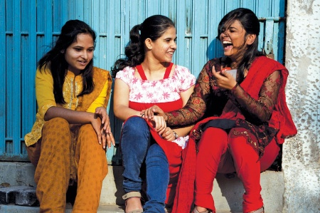 three-young-women-seated-chatting-and-laughin_450.jpg