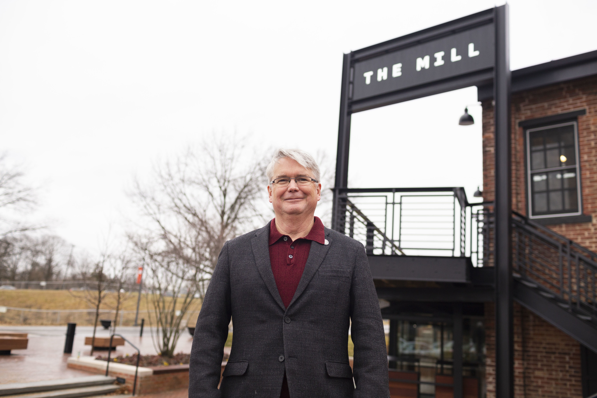 John in front of The Mill, which opened in 2018.