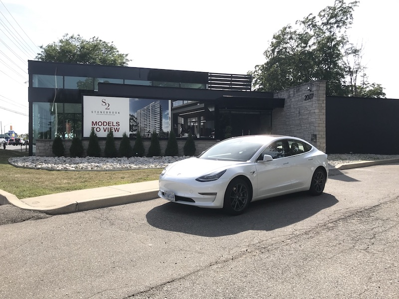 Tesla in front of S2 Condo.jpg