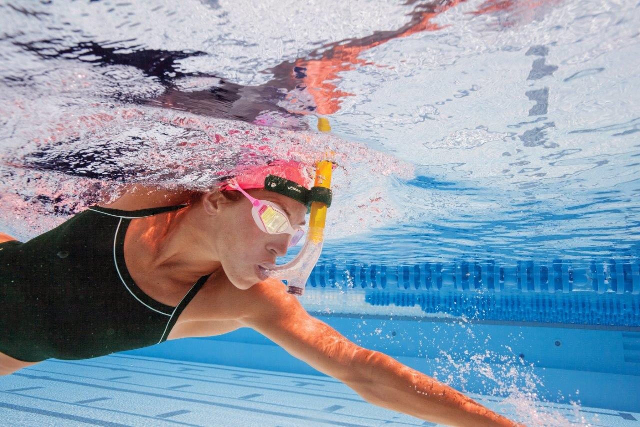 Swimmer using a front training snorkel allowing her to focus on stroke technique