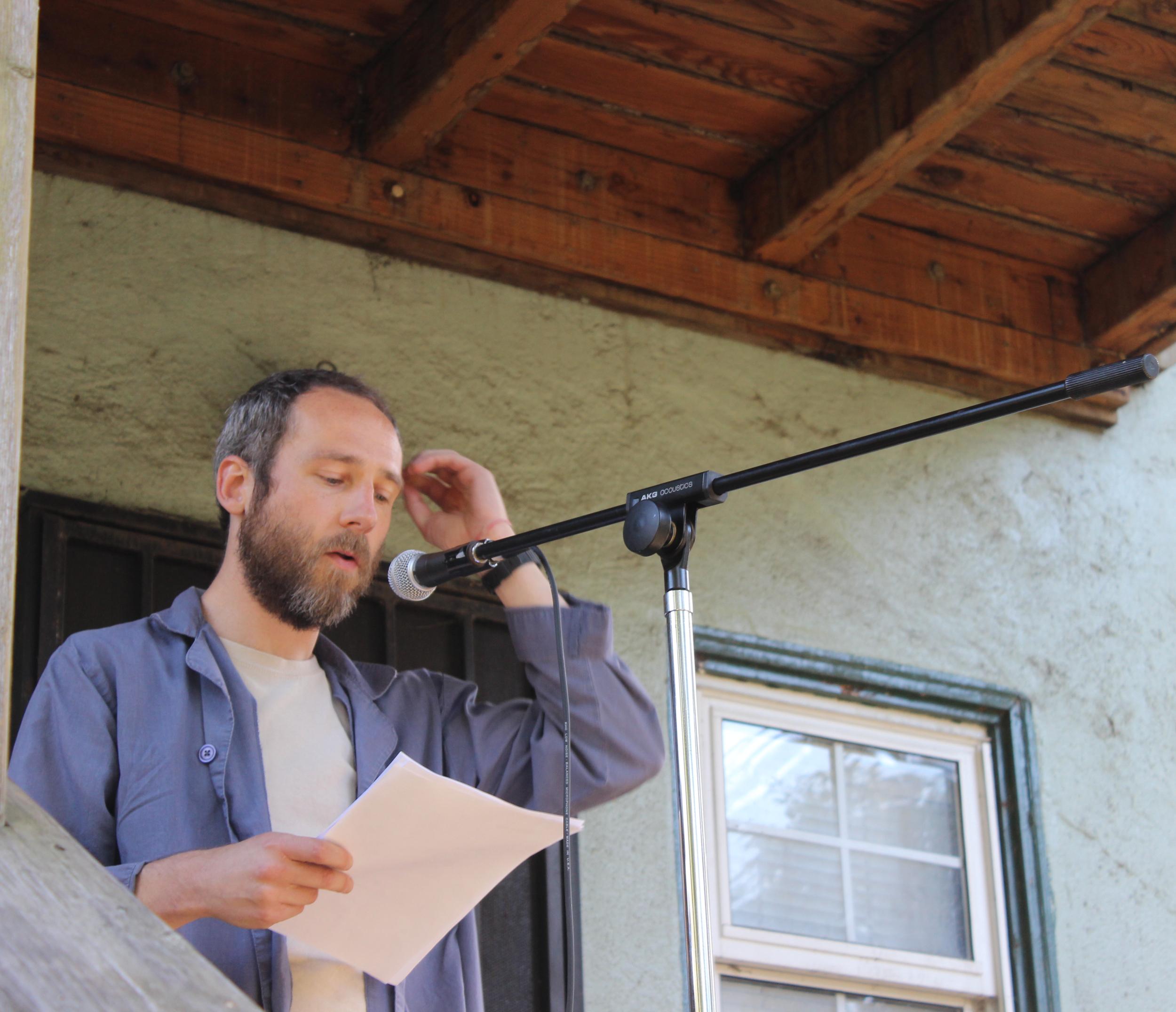 Paul Ebenkamp reads in the Oak Center neighborhood of West Oakland on 5/11/19