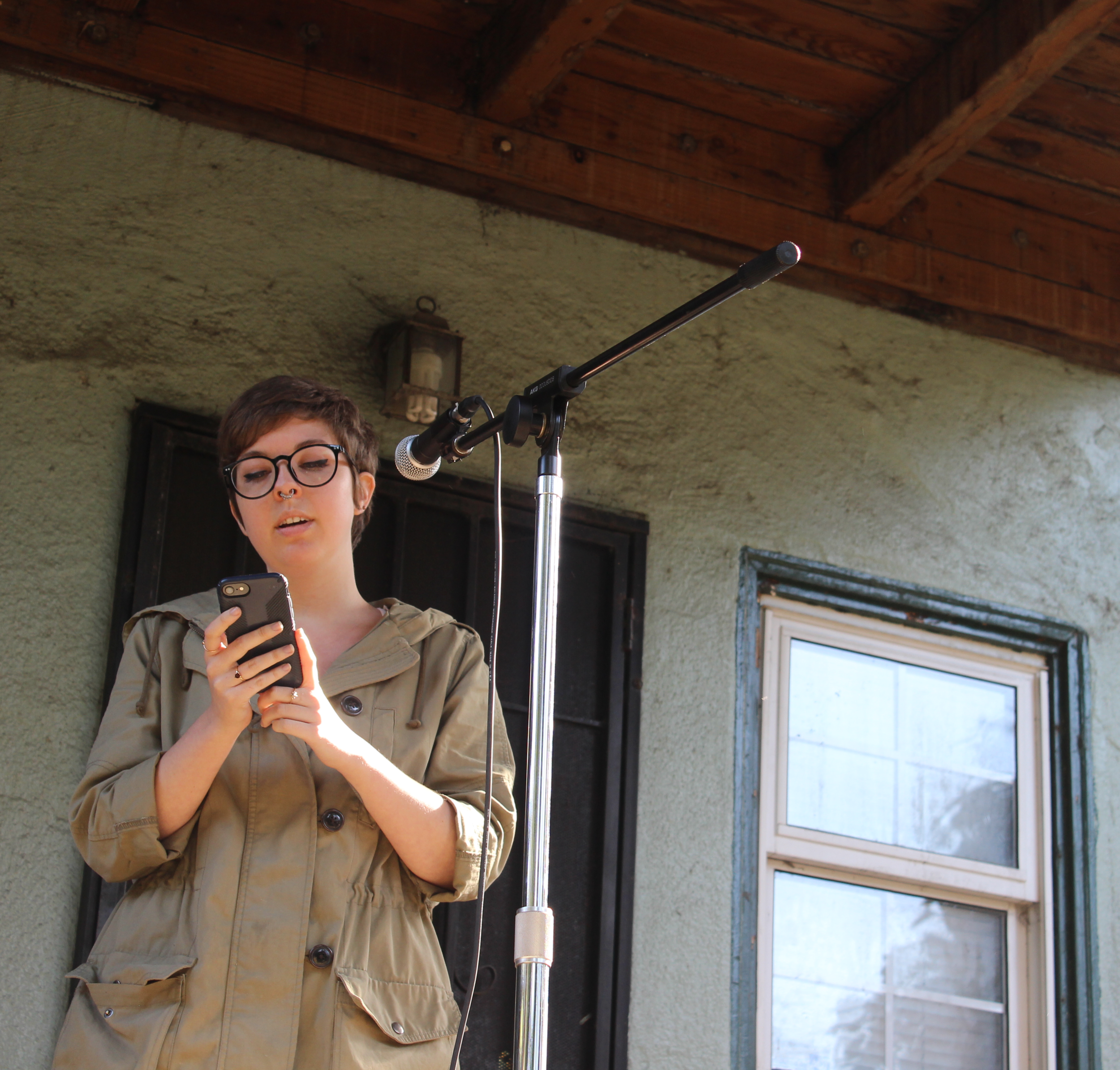 Mal Young reads in the Oak Center neighborhood of West Oakland on 5/11/19