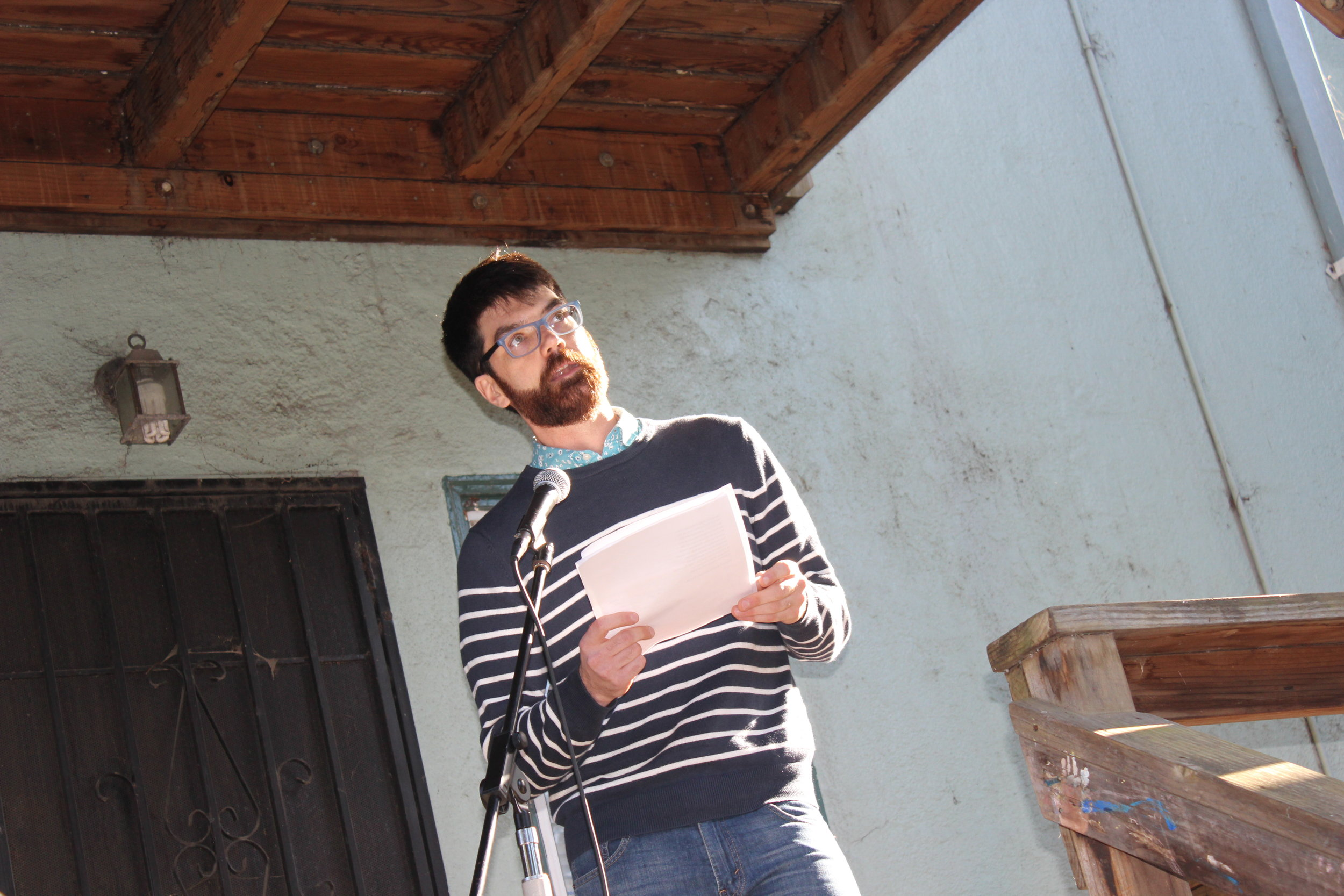 Liam Curley reads on June 1st 2019 in the Oak Center Neighborhood of West Oakland