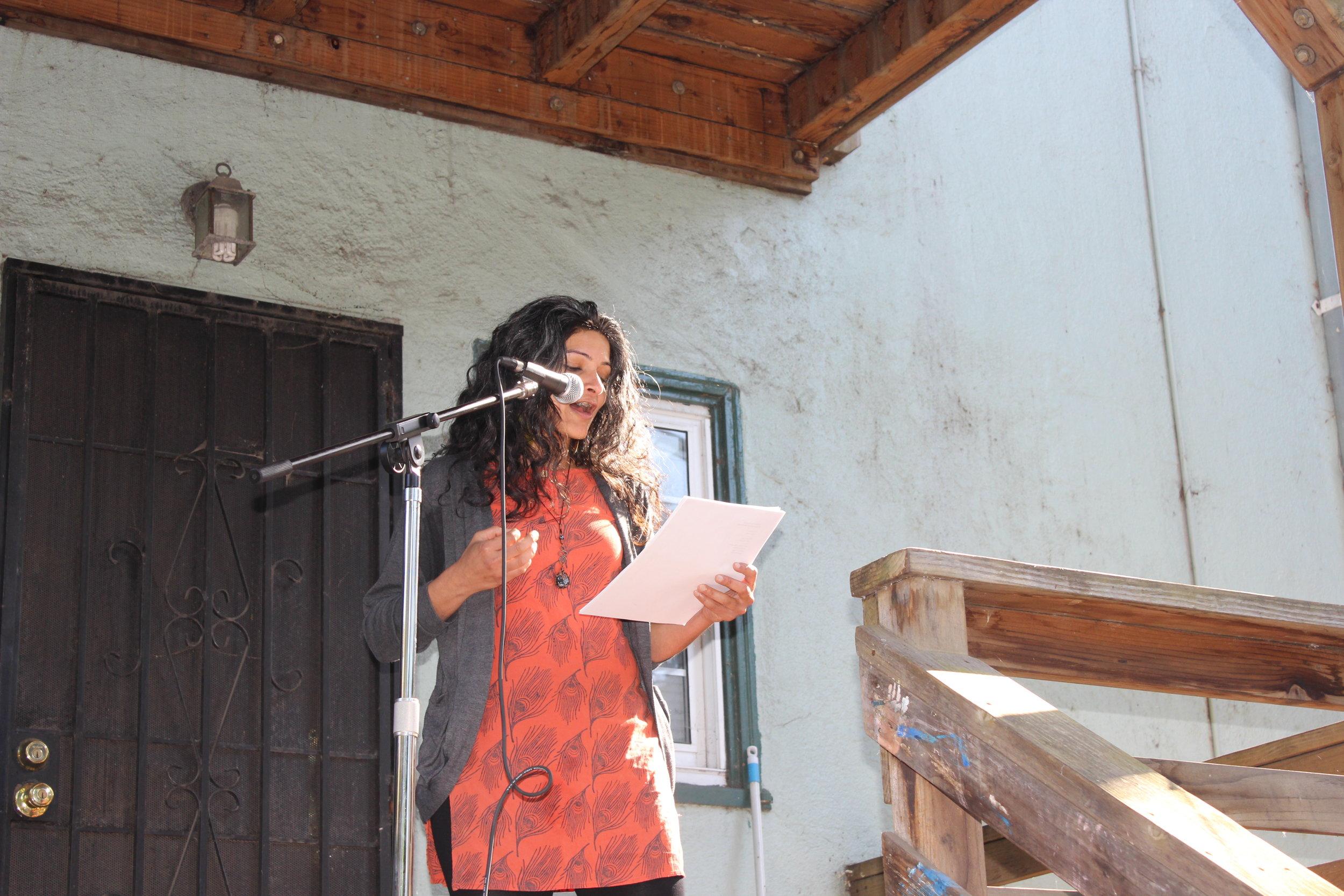 Monica Mody reads in the oak center neighborhood of West Oakland on june 1st 2019