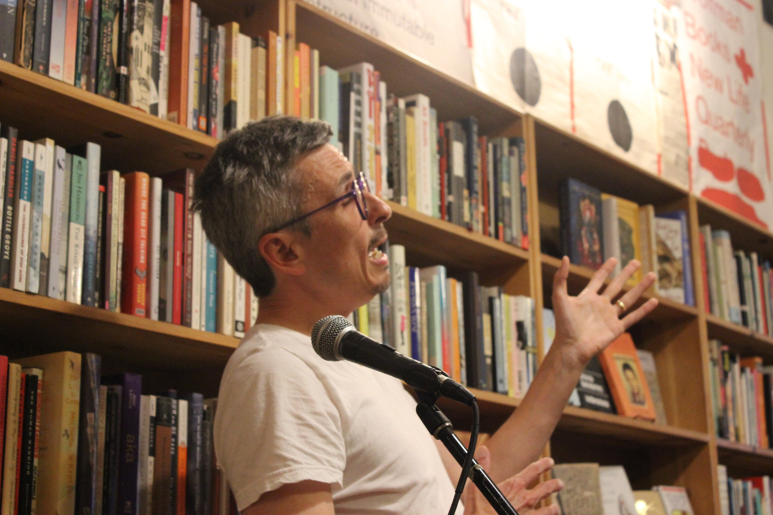 Julien Poirier REads Poetry at Wolfman books in Downtown Oakland in a reading hosted by Sophia Dahlin on 8/18/20