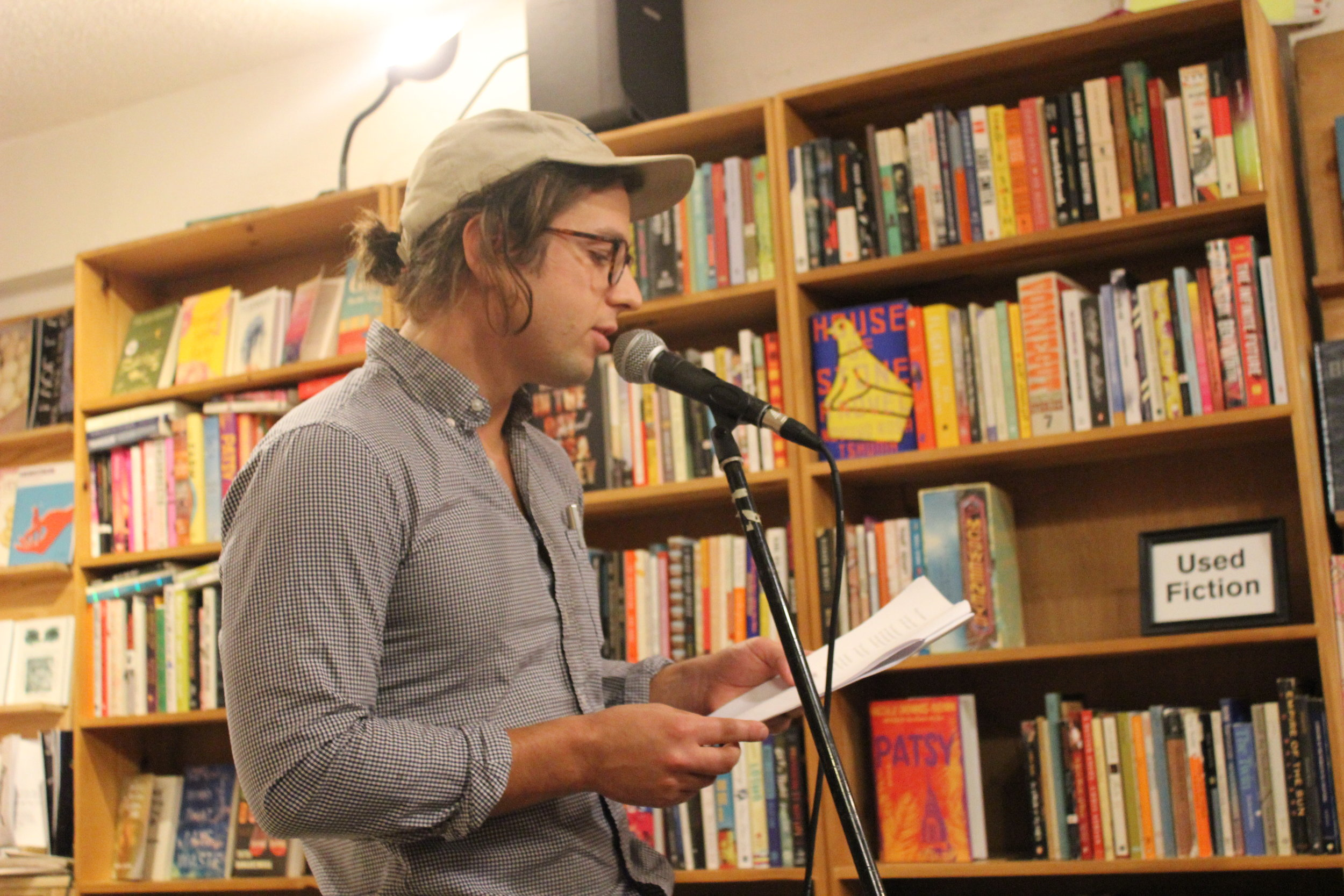 Caleb Beckwith reads poetry at Wolfman Books in downtown Oakland at a reading hosted by Jacob Kahn on 8/19/19