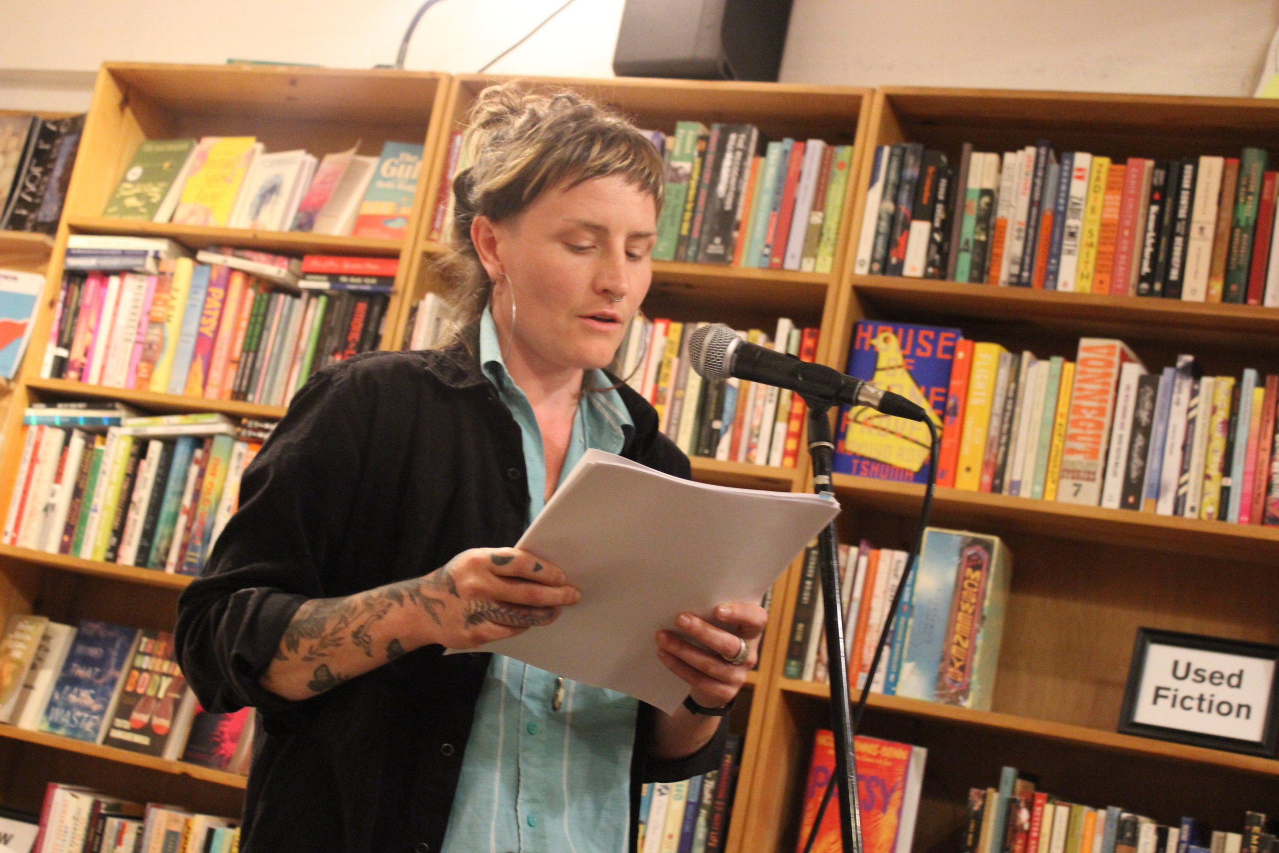 Tessa Micaela Landreau-Grasmuck reads poetry at Wolfman Books in downtown Oakland at a reading hosted by Jacob Kahn on 8/19/19