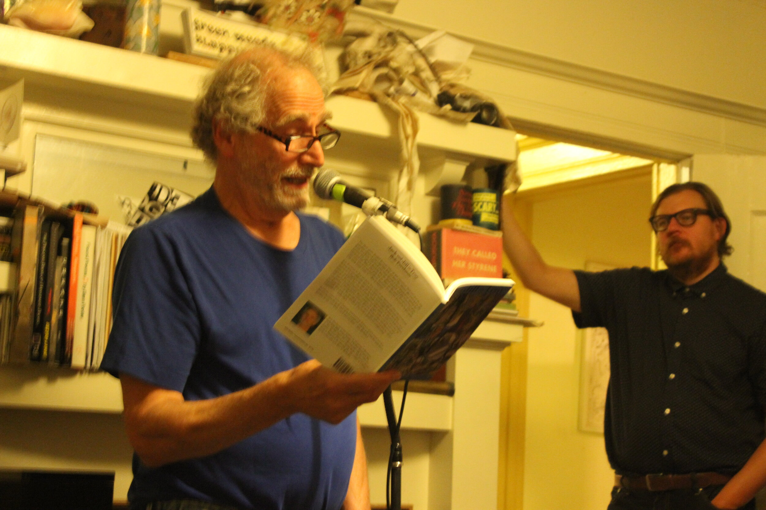 Bob Perelman (left) Reads poetry at The Sponge Series on September 21 2019. Brandon Brown (right) Listens in Quiet Amazement.