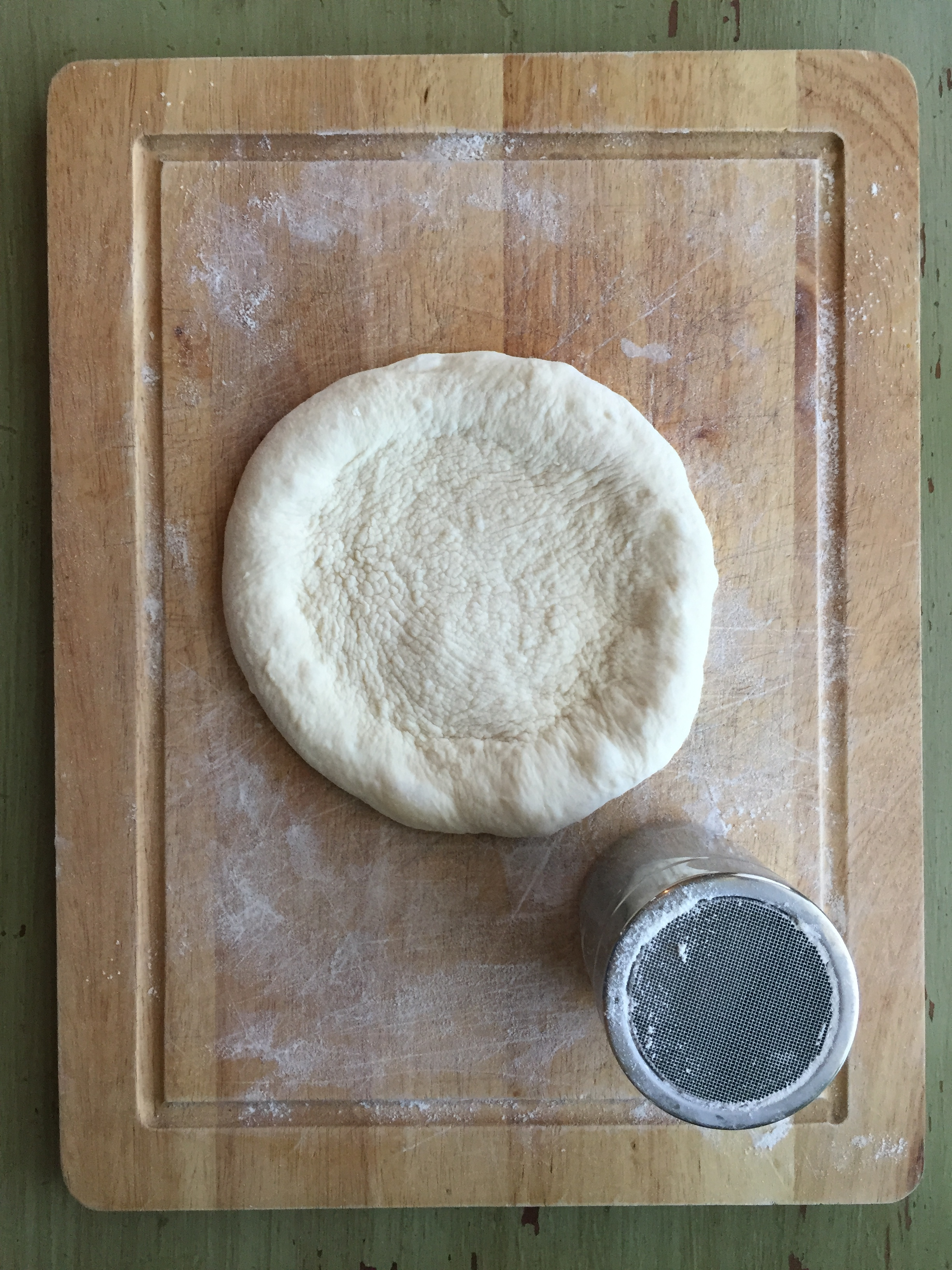 Shaped pizza dough ready for toppings! This dough will stretch out even more after after a few minutes rest.