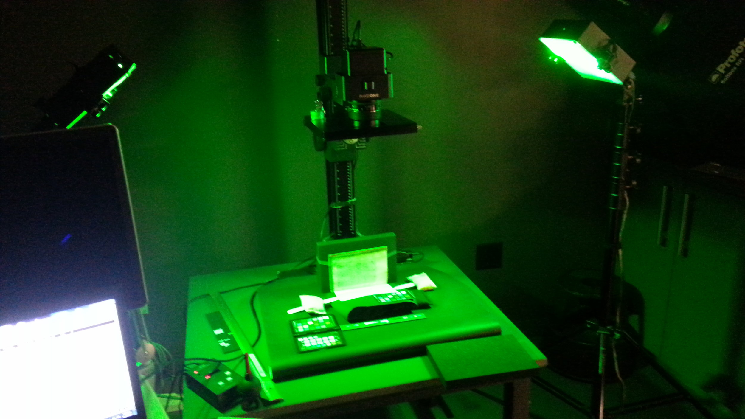 Multispectral imaging of a medieval manuscript—at this particular moment, with a wavelength that appears as green to the human eye. (Part of the Library of Stains imaging process.)
