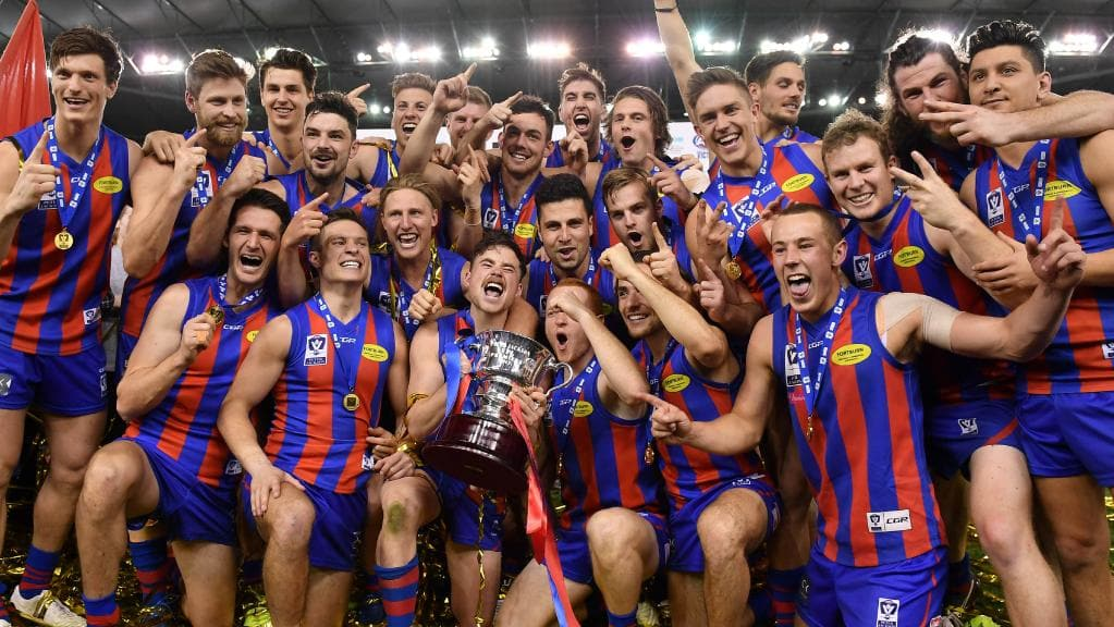 Port Melbourne Football Club players show off the silverware after the club's VFL premiership triumph in 2017.