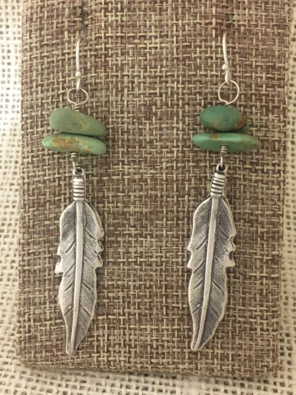 Silver Turquoise Feather Earrings   Two nuggets of turquoise rest above each silver feather. These are simple, but beautiful. The dreamy blue-green hue of the turquoise is swoon worthy. $74