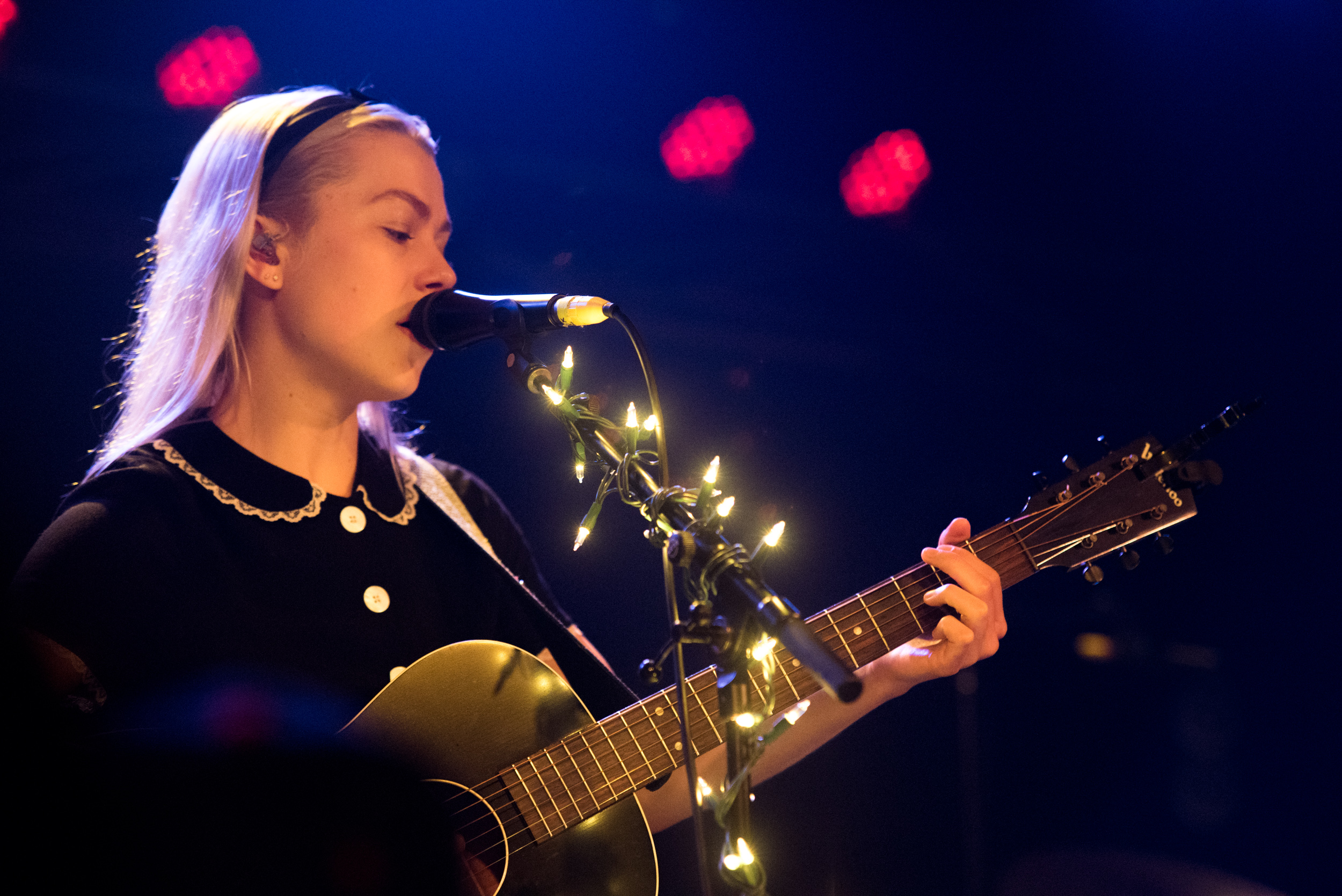 "Review - ""The opening lyric of ""I'm singing at a funeral tomorrow for a kid a year older than me"" is like a punch of reality in the face. The fairy lights on the mic stand allude to the sense of magic Bridgers has and it is palpable in the room tonight."""