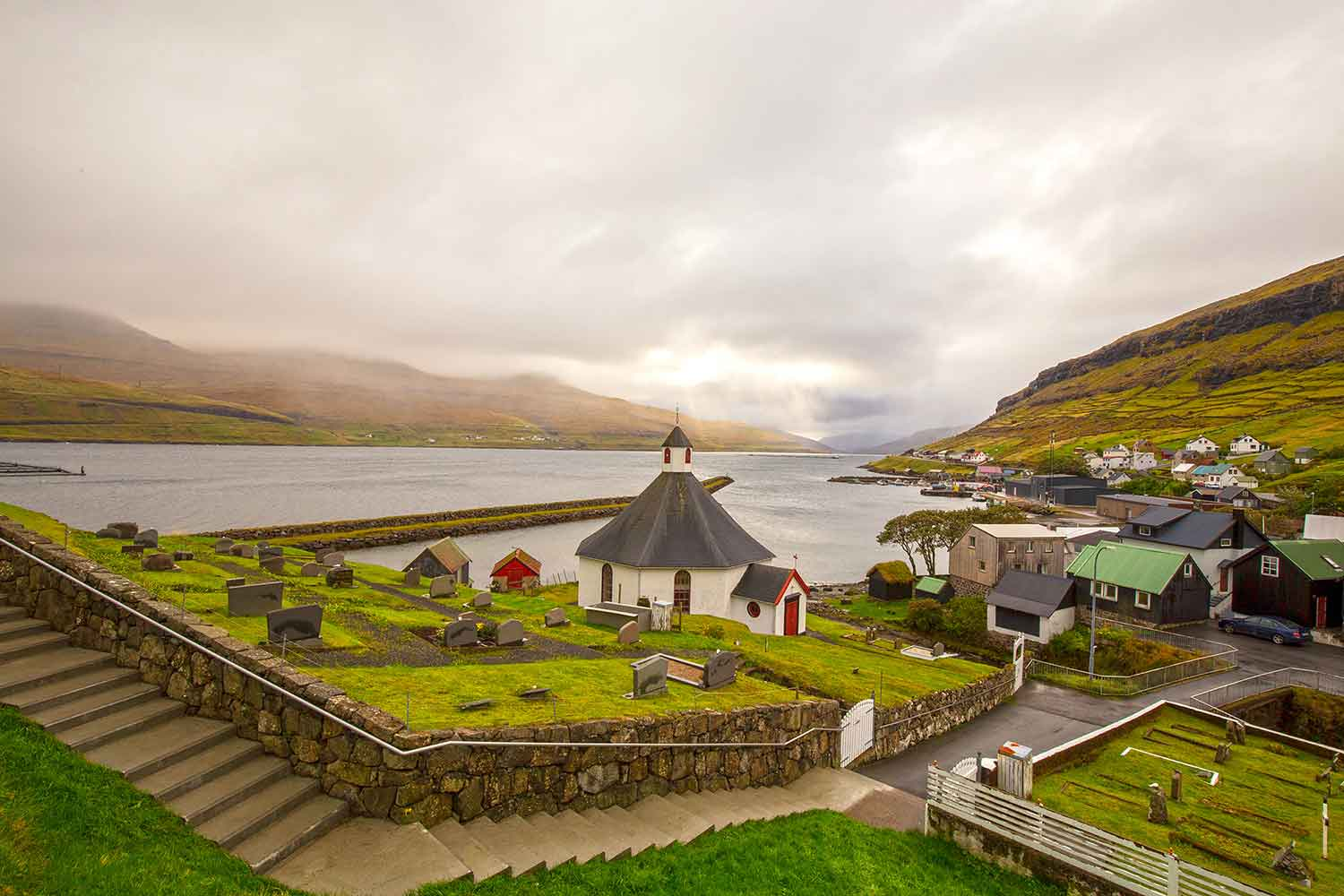 Haldórsvík, population 150, located on the northeast side of Streymoy island. This stone church was built in 1856 and is the only octagon church in all the Faroes. The light comes and goes in the Faroes so quickly.