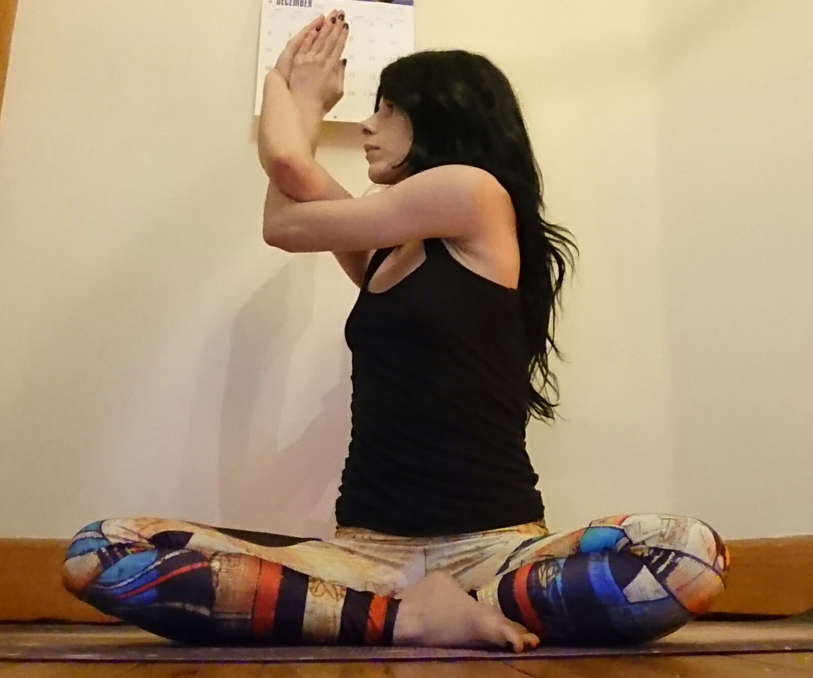 For a deeper stretch, you can twist from the waist a few times turning to both sides.