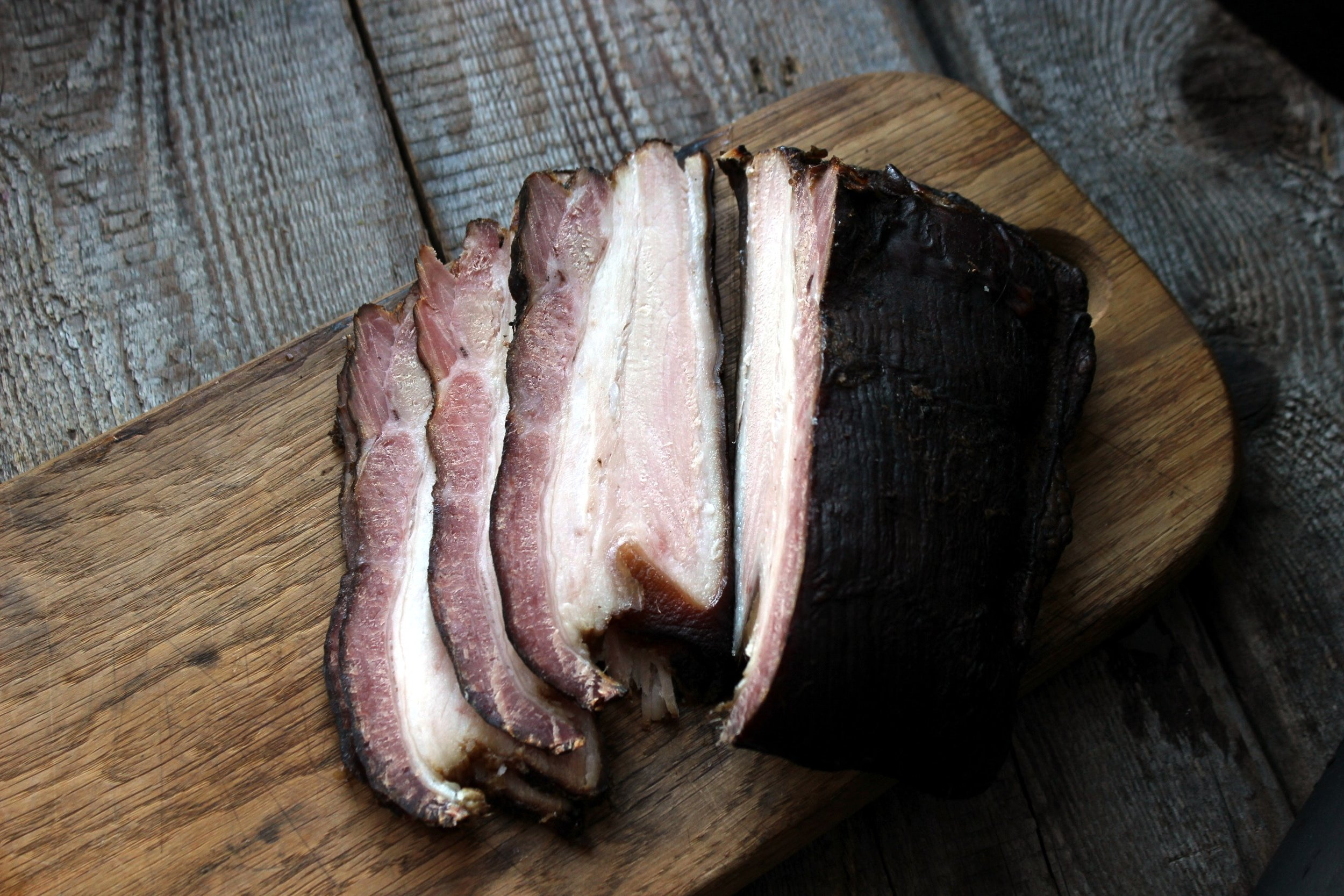 Pork cured and coated with a mixture of carefully blended spices, juniper berries and molasses which permeate the ham.