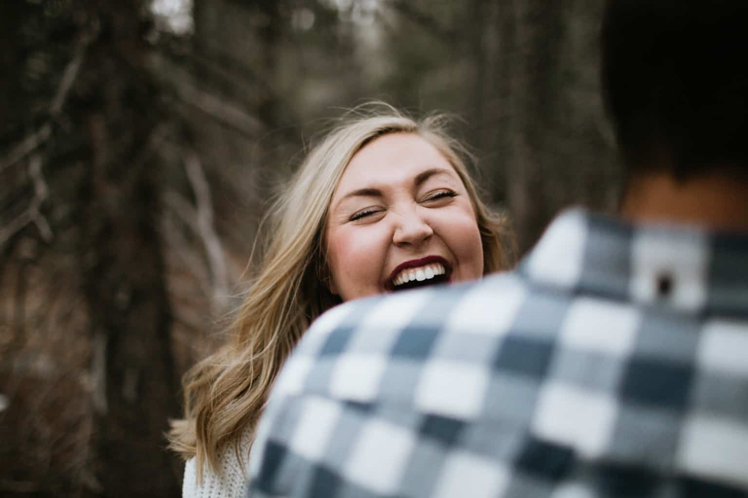 Engaged couple laughing with each other.jpg
