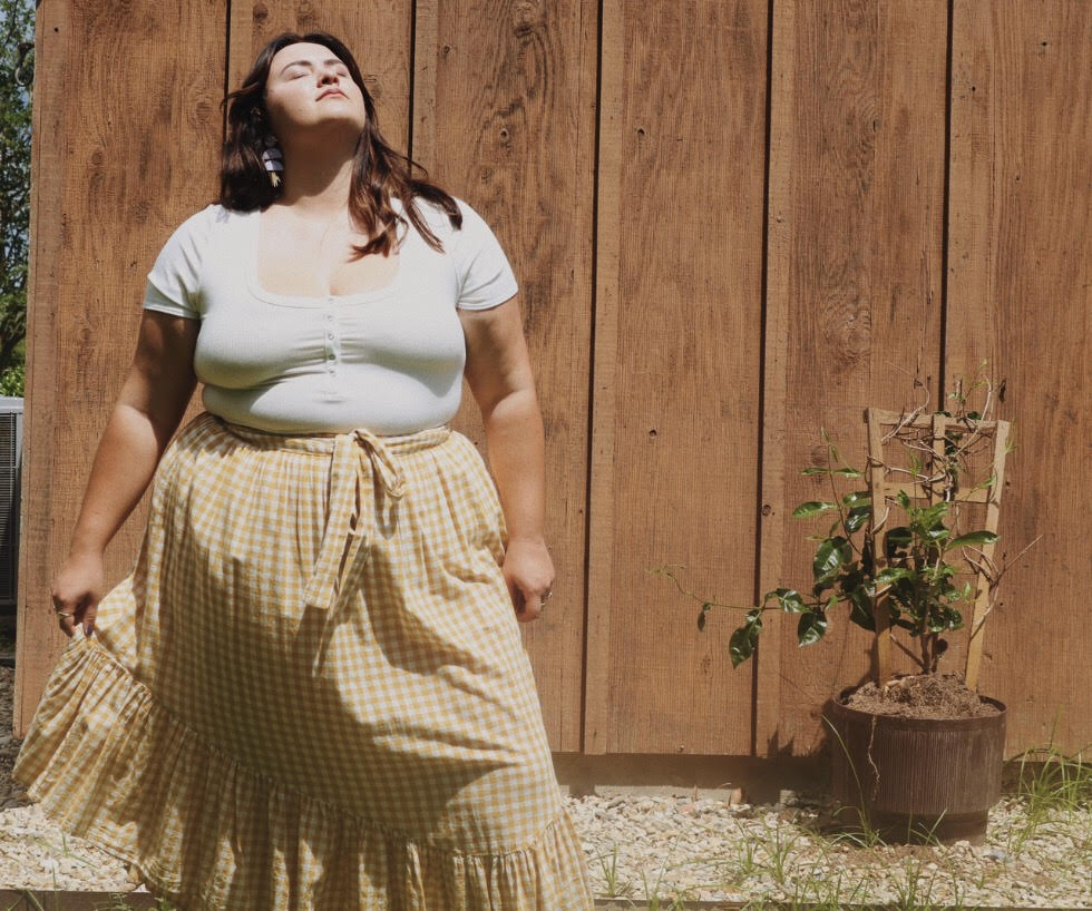 Photo of courtesy of Sydney. Wearing a Reformation bodysuit, ASOS skirt from a few years ago and Sedona Moon earrings.