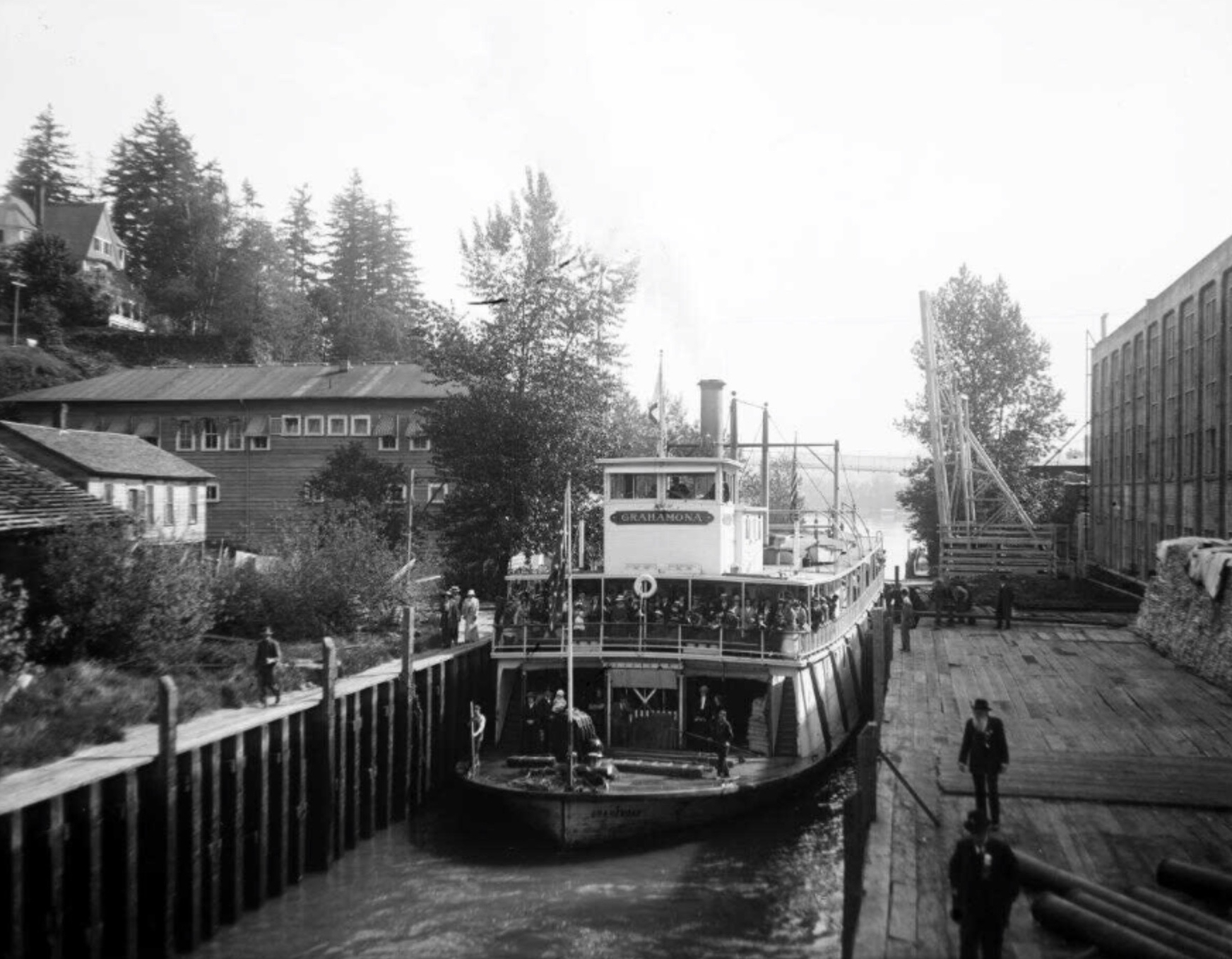 Source.   Stern-wheel steamboat Grahamona in the Willamette Falls locks, sometime between 1912 and 1918.
