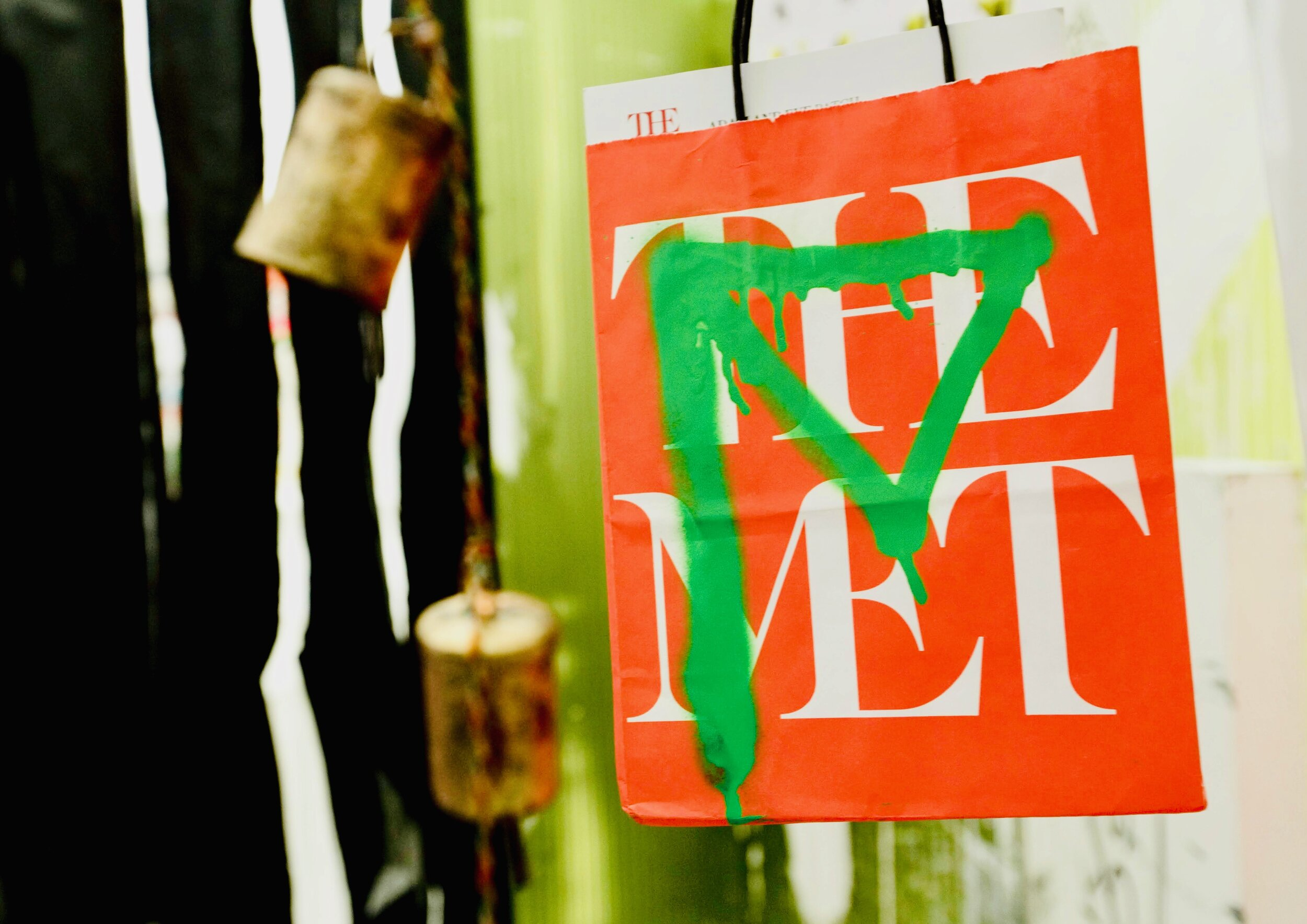 (above) Guzman's signature phantom figure in green adorning a shopping bag from the Metropolitan Museum of Art