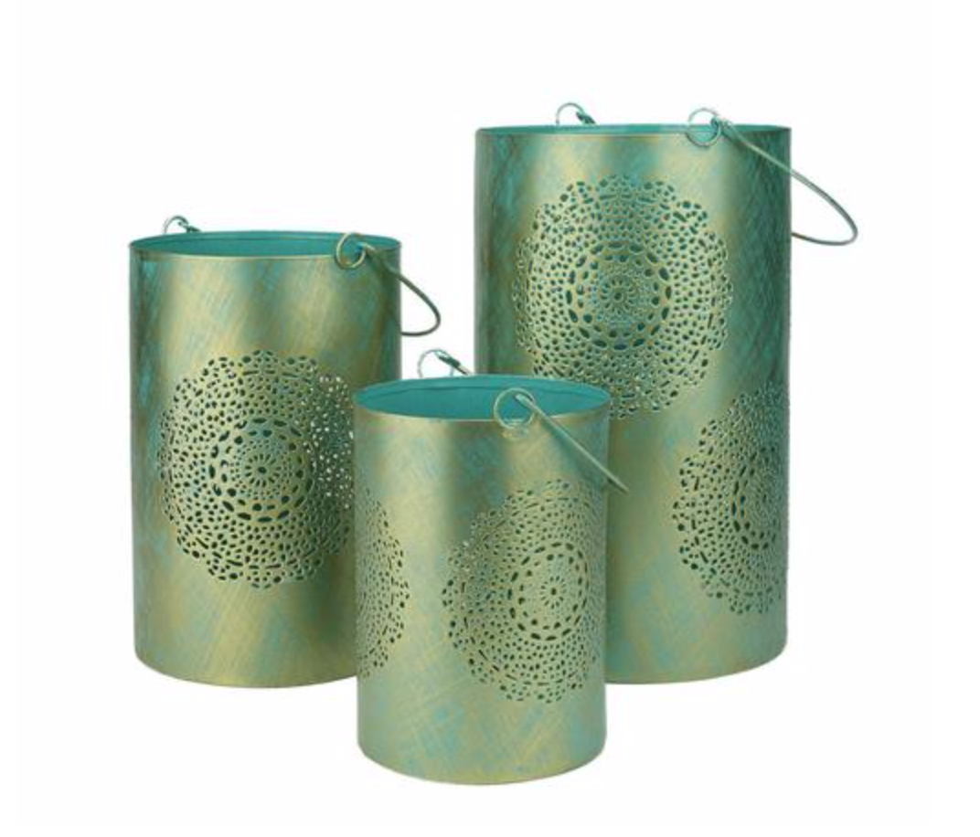 Can't you just picture how pretty this set of three lanterns would be when lit? I love the moroccan look of these. https://www.christmascentral.com/set-of-3-turquoise-blue-and-gold-decorative-floral-cut-out-pillar-candle-lanterns-10/
