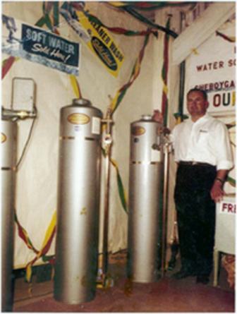 Our founder, Peter Christian, displaying the new automatic water softeners at the 1959 Sheboygan, WI County Fair.